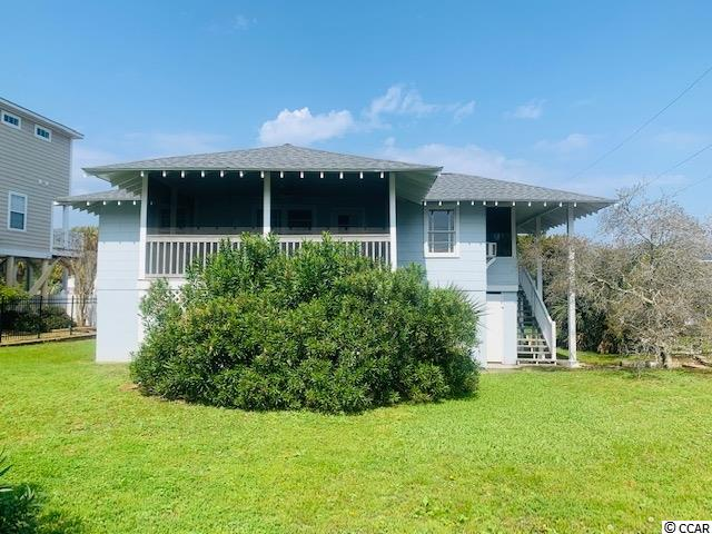 Classic beach house sitting directly on Waccamaw Dr in Garden City. Lot size is 75 X 156 with a view of the ocean as you are sitting on the front porch enjoying the breeze.    4 br 2&1/2 baths sold furnished on a large corner lot and sold in as is condition.  This has been a one family home its entire life and is now time to for a new family to make memories for your friends and family.