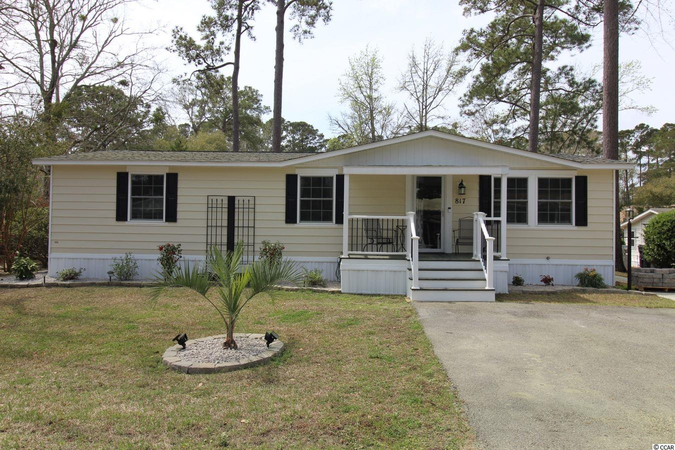 This 2BR/2BA manufactured home which has been completely renovated with high quality fixtures, appliances & laminate flooring is located in Ocean Pines, an active 55+ manufactured home community in Garden City Beach with very reasonable land lease terms. The kitchen features new stainless-steel appliances, including flat top stove and built-in microwave. The spacious master bedroom (15.5' x 11') has a walk-in closet and ceiling fan. There is a sunny Carolina Room (19' x 9.7') off of the dining area/kitchen. Quality crown molding & New double paned tilt windows. There is 16' x 20' deck in the back yard where you can relax with family enjoying the views of a community pond. There is a 10' x 12' storage shed which will convey. Upgraded electrical system and lawn irrigation in the front yard. Roof replaced in September 2014. Residents in Ocean Pines enjoy great community amenities near the Atlantic Coast. Take a walk or bike ride through the landscaped grounds with plenty of shade from the pine trees and magnolias. Beat the summer heat with a few laps in one of two swimming pools. Two clubhouses offer great opportunities to get to know your neighbors during organized activities and planned events. Recreational opportunities include billiards, bocce ball, and horseshoes. Find your new favorite book in the community library. The Ocean Pines 55+ community is conveniently close to retail, restaurants, The Murrells Inlet Marsh Walk and all the attractions & amenities that make this South Strand location special.
