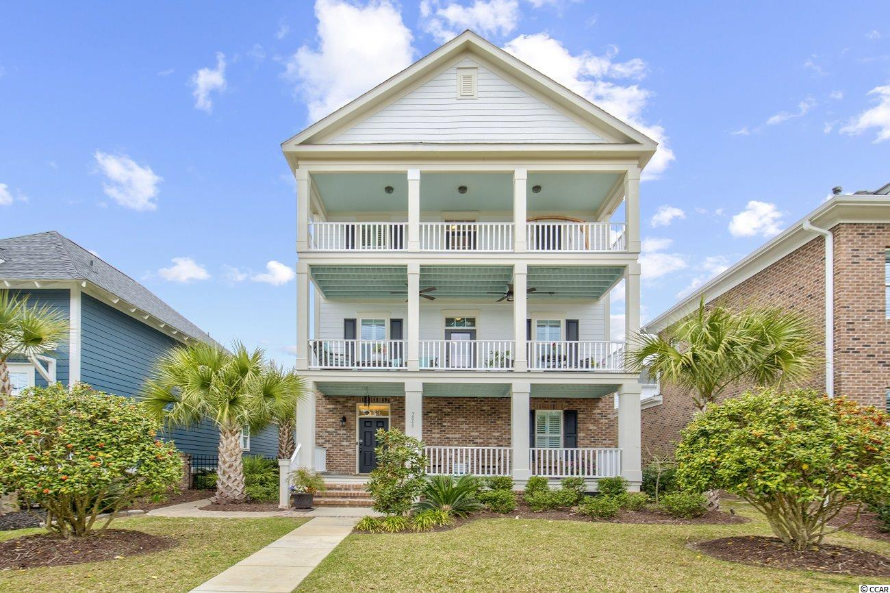 Beautiful 4 bedroom, 3.5 bath home in a unique boutique neighborhood that is close to the BEACH.... Homes like this do not come on the market OFTEN!!! Natural Gas Community.... Built in 2018, this meticulously maintained, Charleston Style Home with PRIVATE ELEVATOR to all three floors, is warm and inviting providing three front porches to take in the ocean breeze just a block away.  The Owners have enjoyed this home very much and have made amazing Upgrades.  They have custom designed their pantry and walk in closet in the master.   Also, completely re-landscaped the entire yard with mature plantings and beautiful outdoor lighting.  The Charleston Terrace with gorgeous dry laid pavers and fencing for privacy.  Another room to this lovely home. Plenty of seating area with fountains and grill area.  As you enter from the covered front porch and step into the foyer, you will immediately notice the 10-foot ceilings that provide the home with a feeling a grandeur.  They did add a side door to the home for easy entry from the terrace area.  On this ground floor level, you will find a bedroom and full bath as well as an additional flex room perfect for an office, exercise room, or any other space you might need. Upstairs you will find the kitchen, dining, and main living area.  The gourmet kitchen features a gas cooktop, granite countertops, a spacious island and custom designed walk in pantry with wine cooler.  The kitchen flows seamlessly into the dining area then into the living room.  As you enter this show stopping living room, the first thing you notice is the amount of natural light coming from all the windows and the beautiful Gas Fireplace.  This living area is open, spacious, and features 10-foot coffered ceilings and overhead ceiling fans.  Upstairs on the top floor you will find the spacious master suite complete with a large master bath, custom walk-in closet, and private balcony.  The remaining bedrooms and a jack-and-jill  bathroom round out the top floor.  W