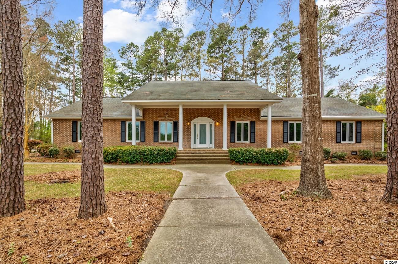 "WOW!!  5,000 sq. ft., all brick construction, HUGE detached garage and workshop, all sitting on a sprawling 3 acre tract of land, and just a 10 minute drive to the beach!!  THIS is tough find along the Grand Strand, but here it is!  This beautiful ""Low Country"" style home has so much southern charm with large columns resting upon a spacious front porch that catch your eye the moment you turn off the road onto the 300 yd. long driveway, making you feel as though you're pulling into your own plantation.  As you walk through the inviting front porch entrance, you'll enter a cozy foyer that leads through to the Living Area, Formal Den, or upstairs - all of which flow beautifully!  The enormous living area allows just about any furniture configuration you can think of, with plenty of natural light.  This home has several skylights throughout and plenty of updated windows to let the sun shine through the home, while also providing near up-to-date efficiency.  The Living Area opens up to Kitchen, providing a spacious area to enjoy family, host guests, dinner parties, etc.  Adjoining the Kitchen opposite from the Living Area, you'll find a large Formal Dining Room that leads back around to the Formal Den.  Again, this home really does have that true ""Low Country"" styling and layout.  Off the backside of the living room is an enormous sunroom that conveniently accesses the Laundry/Utility Room as well.  On the 1st floor, you'll find bedrooms 2 & 3 with guest bathroom, and the Master Suite complete with 2 large walk-in closets and a VERY roomy Master Bath, bosting double sinks, make-up vanity, whirlpool tub, and huge walk-in shower.  On the 2nd level, you'll find bedrooms 4 & 5 that share a 3rd bathroom, and a spacious bonus room between the bedrooms.  The 2nd floor is a children's dream-space!!  This property is truly a MUST SEE in order to properly appreciate what this compound has to offer!!  Come see, while it's still available!!"