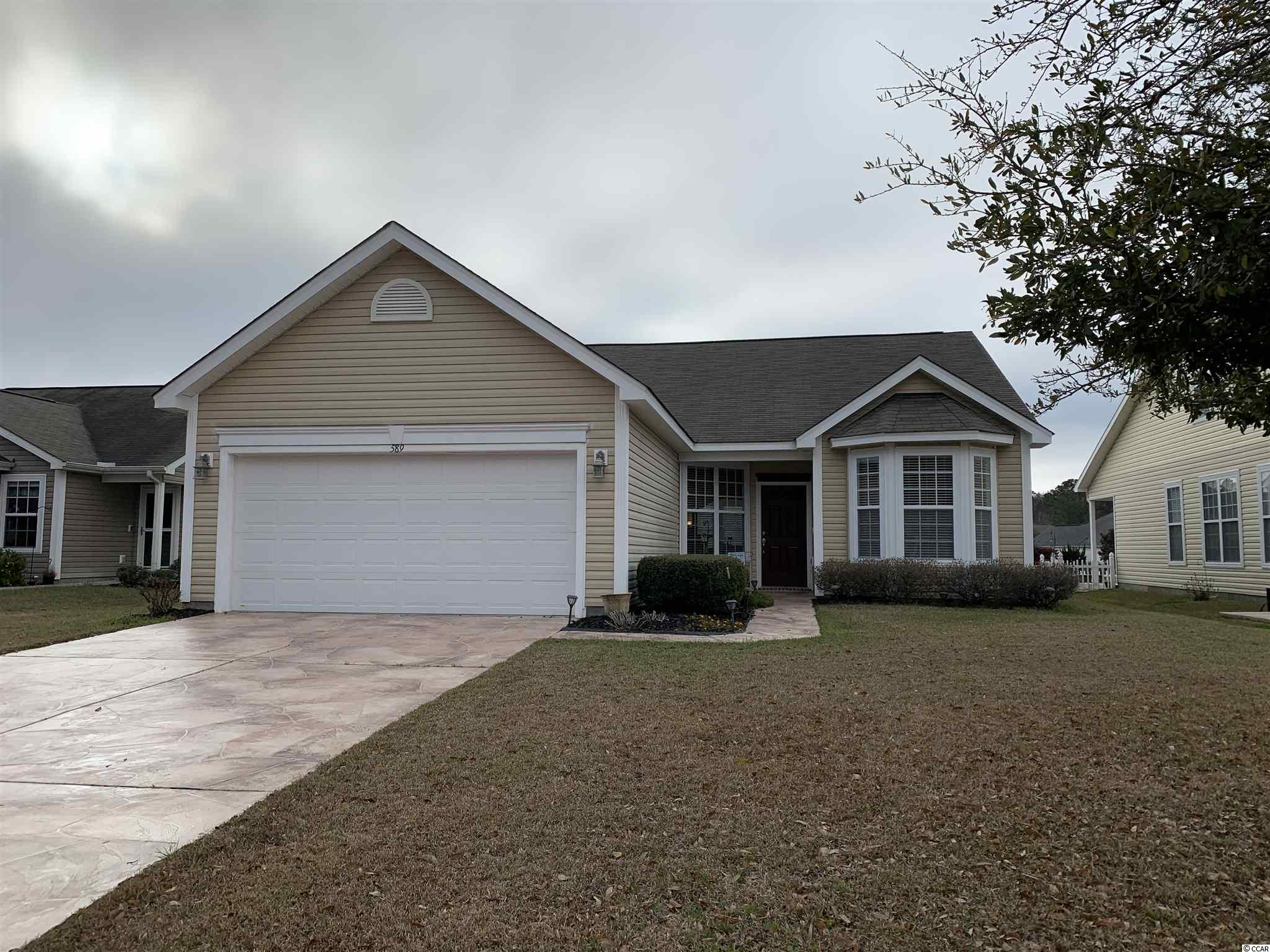 IMMACULATE and won't last long! This well maintained home is in the very desirable and quiet community of Hidden Lakes Village. This home features an open floor plan with vaulted ceilings throughout the main living areas. The master bedroom features a large walk-in closet and the master bath has double sink vanities, an oversized garden tub and an upgraded walk-in shower. The guest bedrooms both have ample closet space and share a separate bath. A screen room was recently added to allow for early morning breakfast or late afternoon get togethers. The screen room and Carolina room open to the backyard that has a 2 tiered stone wall that goes to the waters edge. HVAC system and ductwork were replaced in 2018. New hot water heater installed in 2019. Hidden Lakes Village offers a community pool, hot tub, tennis court and pool house  with playground.