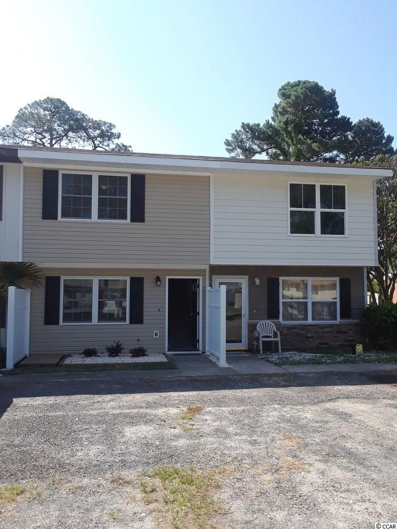 Completely remodeled in the last couple of years from top to bottom! This adorable town home in the heart of Surfside Beach is just a short drive to the attractions and beaches of the Grand Strand. No HOA! This unit has a large living room, kitchen and dining area on the first floor along with a half bath. There is also a laundry room, screened porch, and very large fenced in yard. Upstairs there are two spacious bedrooms and a full bath. New roof, HVAC, appliances, carpet, paint, siding, windows, doors, water heater, fixtures, flooring and fence!