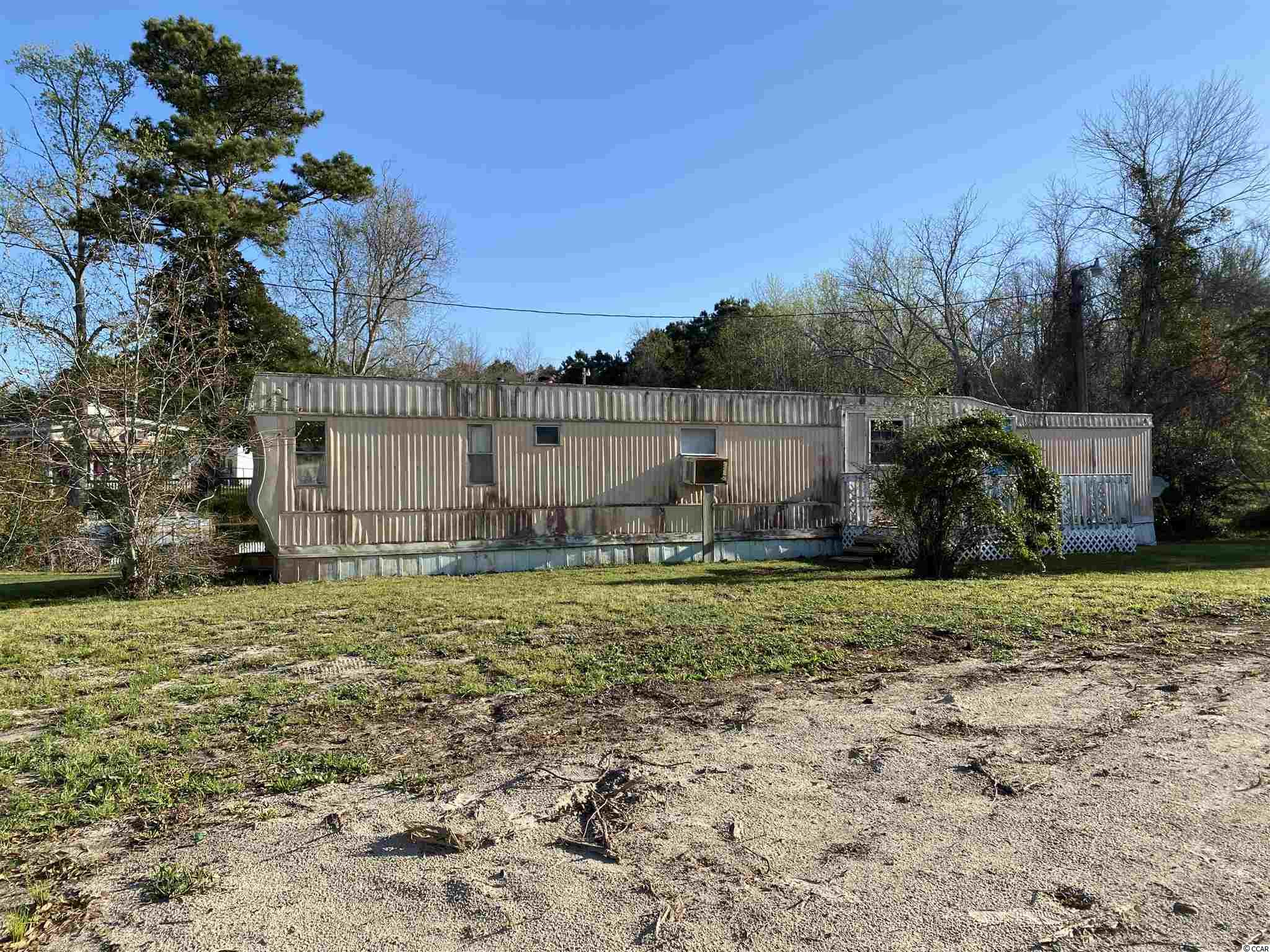 The value is in the two lots. The manufactured home is uninhabitable. Structure is unsafe for occupancy and viewing. This lot you can build a house, have a manufactured home, or a modular home on the property. With NO HOA's!! You can ride your golf cart to the beach from this property. This lot has all the potential for what you are looking for! A piece of the beach that you can call yours that is at an affordable price! Measurements are approximated and must be verified by the Buyers.