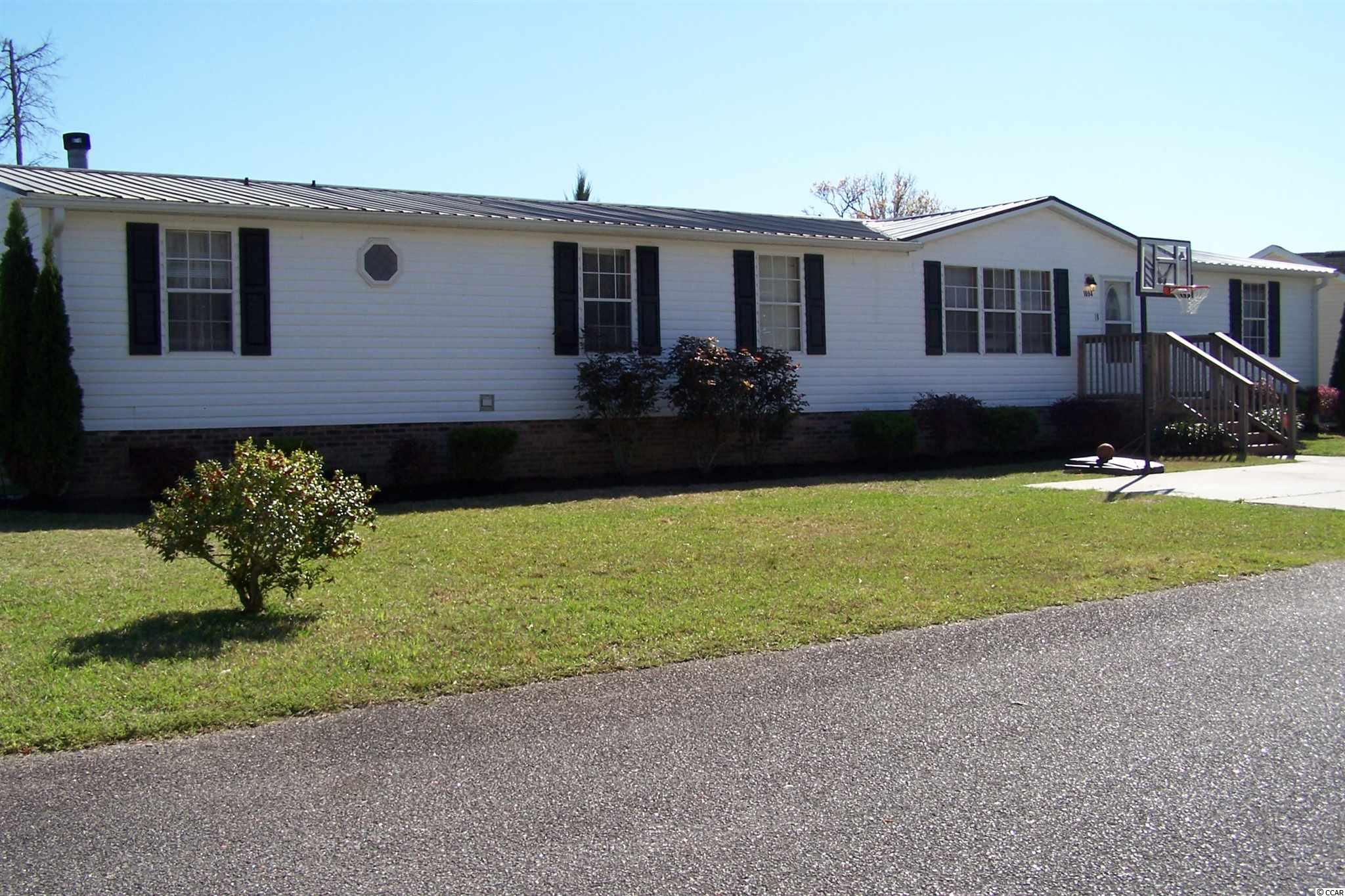 Only home in Weslin Creek active at the moment!. This large manufactured home on its own land is perfect for your larger family. This home also has a room just off the Master suite ( 13 x 9)  that can be a master sitting area, office or with a wardrobe added, a 5th bedroom! Master bath boasts a jetted tub and separate shower. A living room and family room with a wood burning fire place give you lots of living space.  Stainless steel kitchen appliances even features a double oven and lots of kitchen countertops. Refrigerator is new. Fenced in Backyard is nice size with a 8 x 10 shed and a large deck off back door.  Weslin Creek is just minutes from Surfside Beach, shopping and dining.