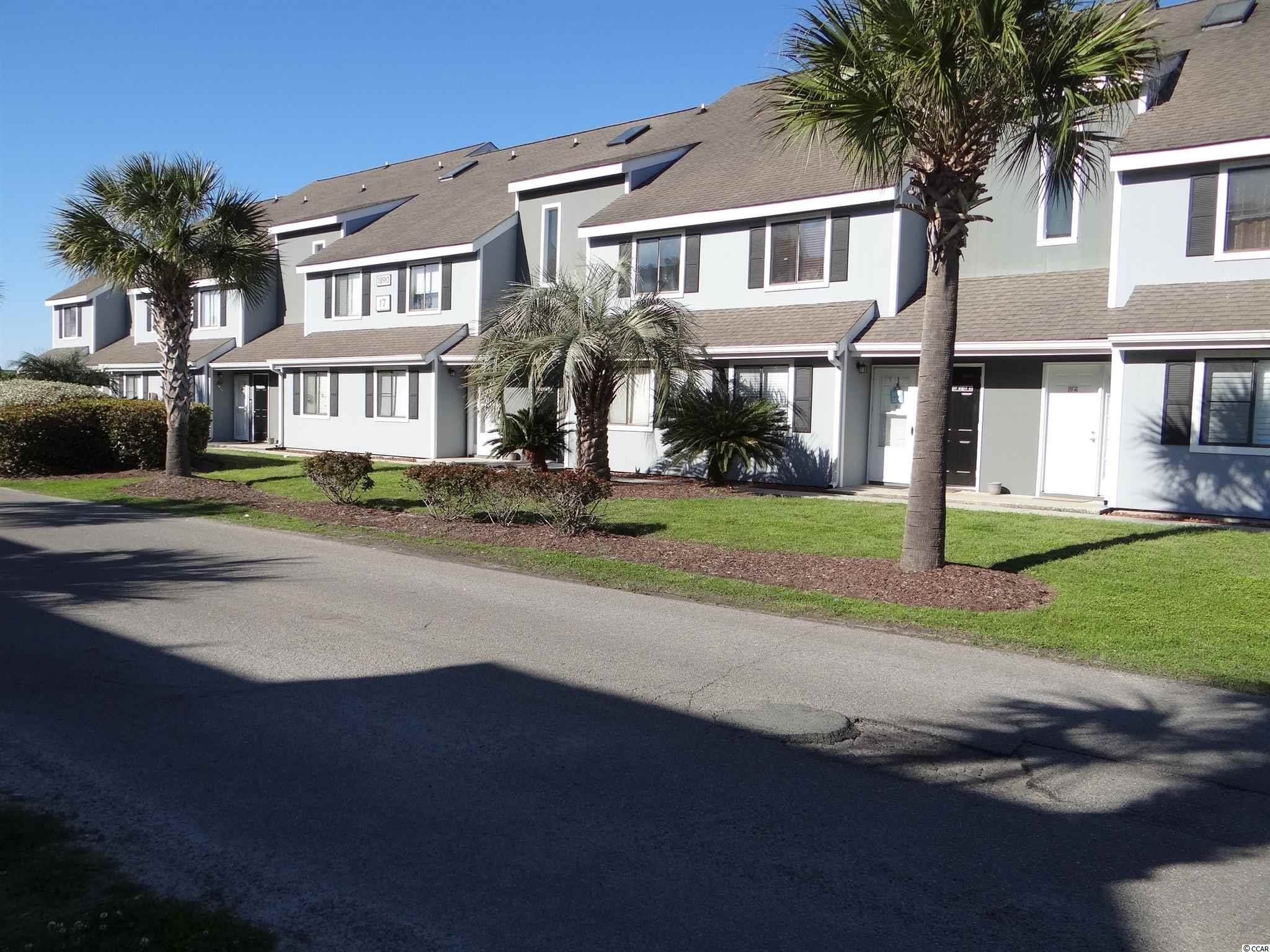 Wonderful Golf Colony Resort first floor, 2 bedroom, 1 and 1/2 bath condo right on the swimming pool. Just painted with Luxury Vinyl flooring throughout the home. Conveniently located in Deerfield Plantation of Surfside Beach, SC minutes away from the Atlantic Ocean, shopping, dining and entertainment. Entering into the condo one proceeds down the hall with two bedrooms on the left and the full bath. On the right side of the hall is a half bath and seperate storage area. Walking further leads to an open living area with kitchen, dining and seating/lounging area. Out through glass sliding doors is a screened porch overlooking the pool and landscaped area. Laundry room is off the porch with washer and dryer included. This condo is a great investment for vacation or long term rental, a second home for weekend and summer/ winter getaway to the beach or your permanent residence. The monthly HOA includes water, garbage, cable tv, internet, pool service, pest control and common area maintenance. Tennis courts and private mail box are close by. Have your real estate agent show you this great condo today.