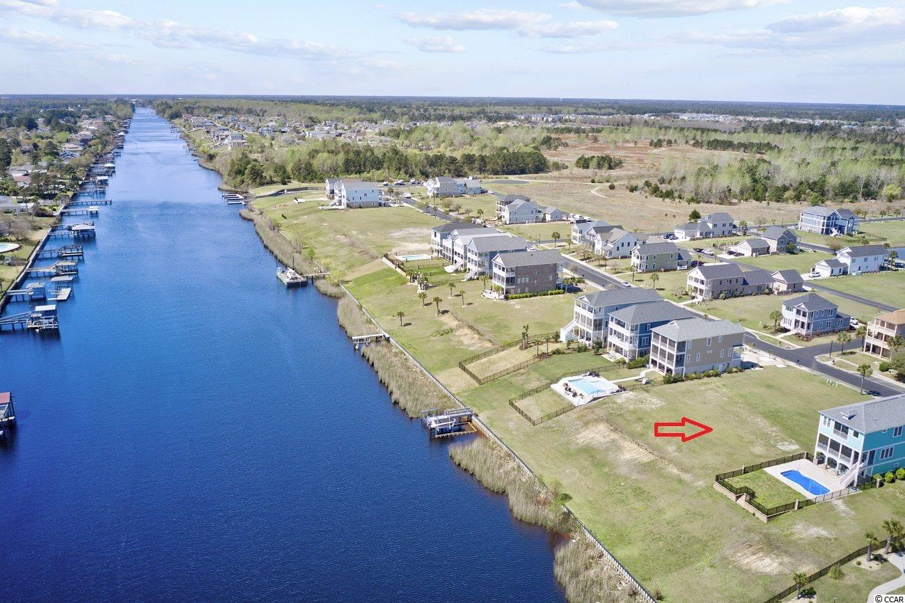 Build your dream home on this amazing waterfront lot in the prestigious gated community of Waterway Palms Plantation! This 0.24 acre lot situated directly on the intracoastal waterway provides you spectacular views and direct access to the water right in your own backyard. With no time frame to build and the ability to bring your own builder, this is your chance to build the custom home you have been dreaming about. Waterway Palms Plantation community offers wonderful amenities including a clubhouse, pool, tennis courts, boat launch, boat storage, 14-acre lake, playground and more! Conveniently located near schools, shopping, dining, entertainment, golfing, area attractions and just a few miles away from the beautiful Atlantic beach!