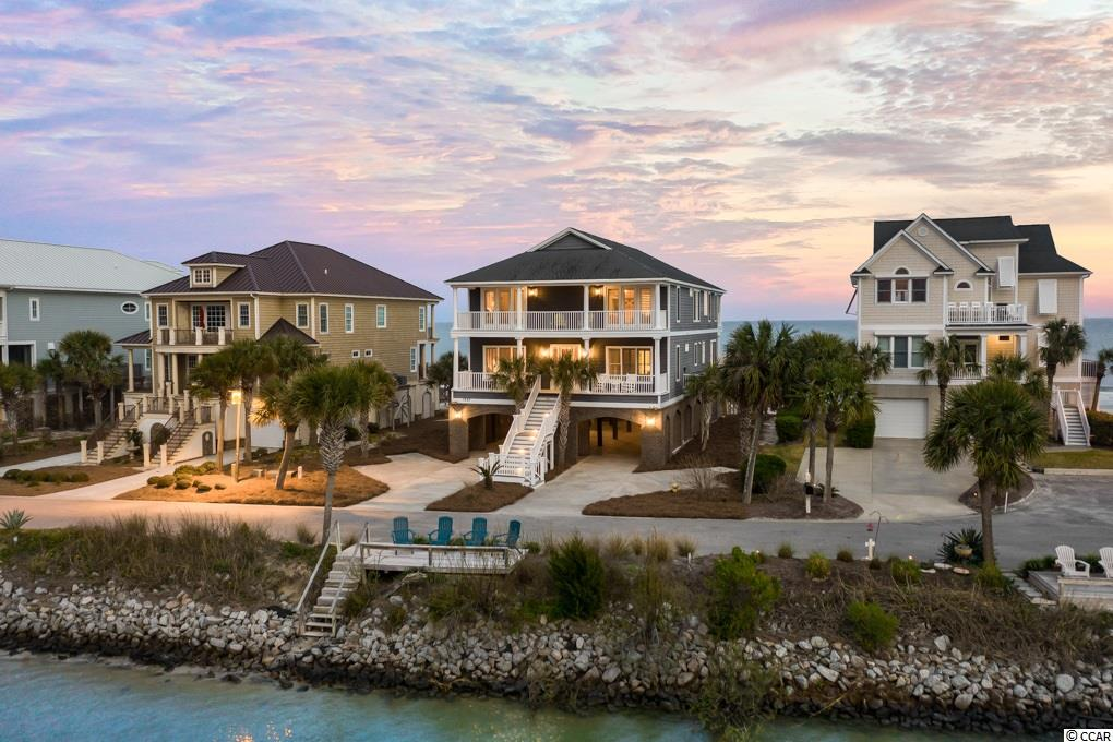 This southern gem is known as Palmetto Sun and is located on the Peninsula at Inlet Point. It is a highly desirable home with a beautiful marsh at the front door and the Atlantic Ocean at the back door. Palmetto Sun is one of the only houses on the Peninsula with a pool, and it has an elevator that provides access all the way to the top floor of this beautiful home. This home has 6 bedrooms and 6.5 baths and also comes fully furnished. On the top floor, there are two master suites that share a balcony looking over the Atlantic Ocean. location has a lot to offer; there is a private boat ramp and access to the marsh and ocean. This home is in a very quiet community but is only minutes away from great shopping and local dining spots. Palmetto Sun is conveniently located only 25 miles away from Myrtle Beach International Airport and 70 miles away from Mt. Pleasant.