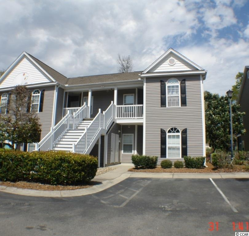 Three bedroom 2 bath spacious unit all on one floor...first floor.  Generous space for full time living or for a second home.  End unit has lots of natural light.  Community pool and visitor parking.   Gated community.  Located in the middle of town close to shopping, beach and golf.