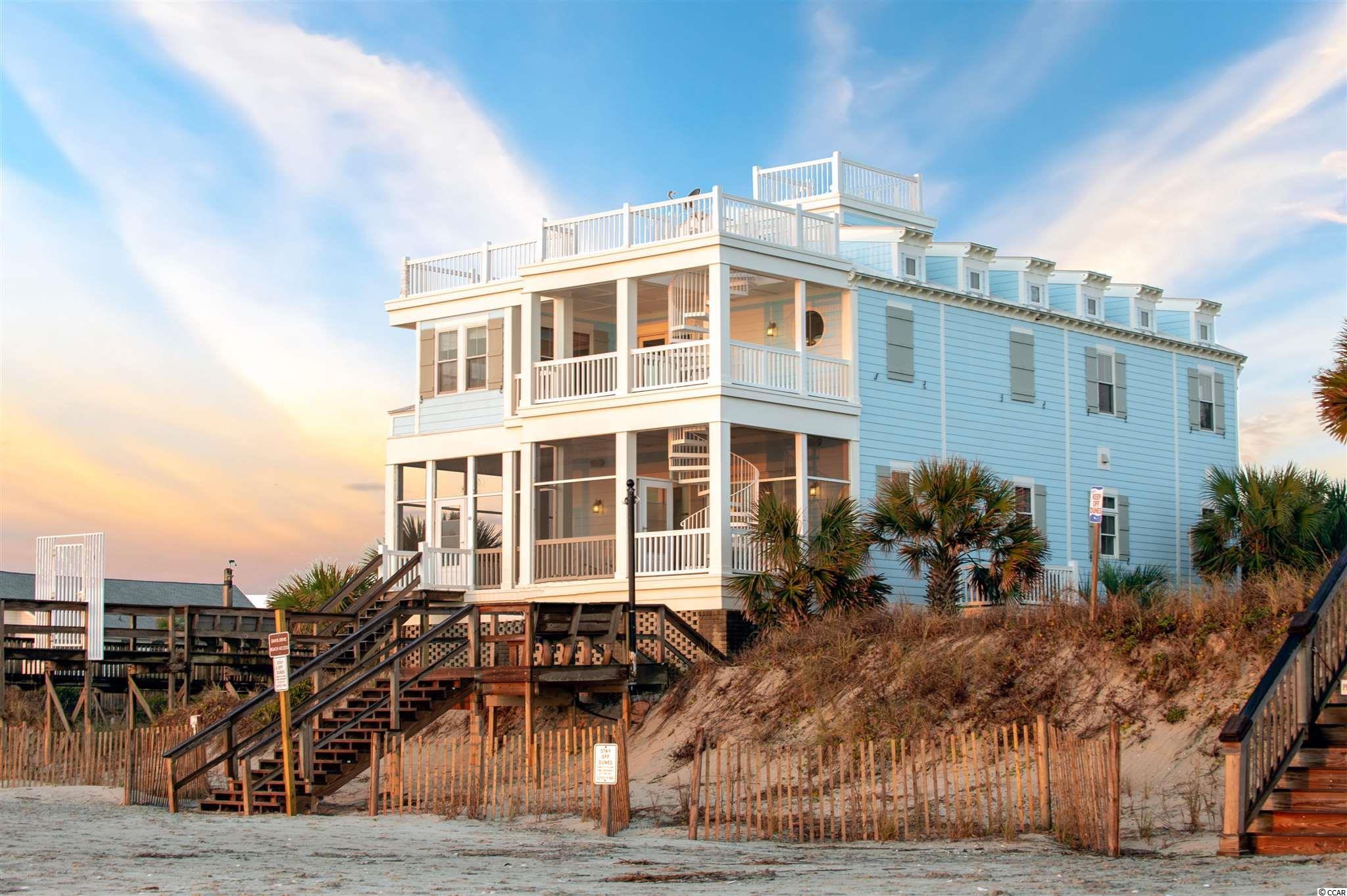 "An unparalleled opportunity to own a stunning oceanfront, 5 bedroom, 4 bath home constructed in 2008 with direct, private, gated access over the dunes to the Pawleys Island beach (which experienced a substantial renovation 2019-2020).    Completely reconstructed from the ground up in 2007-2008 and repainted in its original ""coastal blue"" color in 2019, 296A Atlantic Avenue offers numerous amenities and spacious indoor and outdoor living with unmatched beach and ocean views. In addition to its 3365 sq. ft., there are 2174 sq. ft. of screened porches and covered and uncovered decks. The front (oceanside) porch contains a winding external staircase providing access to the master bedroom front deck, upper decks and crow's nest allowing 360 degree views.   The residence's siding is Hardiplank with a 50 year, transferable warranty, porches and decks are TimberTech with a 25 year warranty, and sliding glass doors and windows are impact and wind rated. The roof is metal and pitched, which allows the unique ""fish head"" rafters to be visible from three sides and the upper decks. The site is heavily landscaped, including 17 mature palm trees (33 including the vacant lot), and is fully irrigated.   The street level contains a parking apron and four car garage with enclosed storage areas and a roughed-in elevator shaft (which continues upward to the first and second living areas). The house entrance stairway is accessed directly through the garage or through an entry courtyard.   All of the first level living areas have 10 foot high ceilings. This level contains a great room with sliding glass doors fronting the beach and ocean, a gas fireplace and a wet bar with ice machine and wine rack, ceiling fans, a gas fireplace and extensive dark wood cabinets and built-in bookshelves, accentuating the light oak flooring of the great room and kitchen. The kitchen contains a gas range, electric oven and microwave, custom cabinets, center island and other extensive counter space. Kitchen and wet bar backsplashes are tiled to extend the soft tones and coastal feel of the first level living area. The laundry room appliances are built in, there is extensive cabinet and countertop space and a sink, and space for a second refrigerator is provided. The first floor also contains a carpeted large bedroom with a walk- in closet and adjacent sunroom and a full bath with tiled floors and shower.   The upper living contains the master suite, three additional bedrooms and two additional full baths. There are 10 foot ceilings in the master suite and 2 of the 3 other upper level bedrooms allowing soft tone upper track lighting as well as ceiling  lights with fans.  The bedrooms are carpeted, the baths are tiled, and hallway flooring is light oak complimenting the first level flooring.    The master suite contains a large bath with tiled shower and separate tub, large walk- in closet, and an office area. All upper bedrooms have extensive ocean views and direct access to the upper decks.   Mechanical systems are under contract to be periodically inspected, and, if necessary, upgraded twice annually.  HVAC and water heater closets are on both living areas, and additional HVAC equipment serving the upper level living area is in the accessible attic. A central vacuum system services all first and second level living areas.   296 A Atlantic Avenue presents a truly unique opportunity to own exceptional Pawleys Island beachfront property! Furnishings are negotiable."