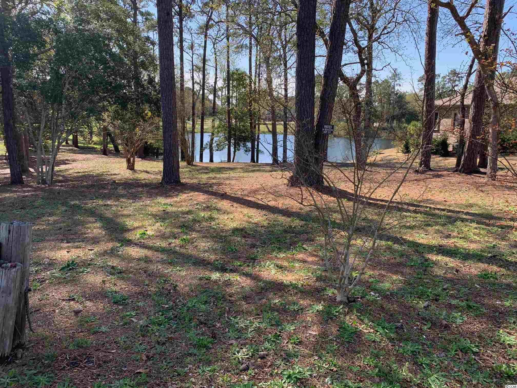 "Rare opportunity to own a prime .88 acre lot on Heart Lake East of Highway 17 and in the middle of all that North Myrtle Beach has to offer.  This prime building lot is only 1.5 miles from the Sandy white beaches of North Myrtle's Ocean Drive beach area and is in Flood Zone ""X"" not requiring flood insurance.  The Lot offers tranquil views of Heart Lake and is only blocks from abundant shopping, dining and entertainment.  Surf Club Golf course with-in view of the back of the property.  Take your golf cart for a day at the beach, or a day of shagging on Main St.  Dimensions and lot size do include ownership of the lake. This is a Natural Gas Community.  No minimum square footage requirement to build and no HOA.  There are some lake restrictions.  All other building restrictions per City of North Myrtle Beach Approval."