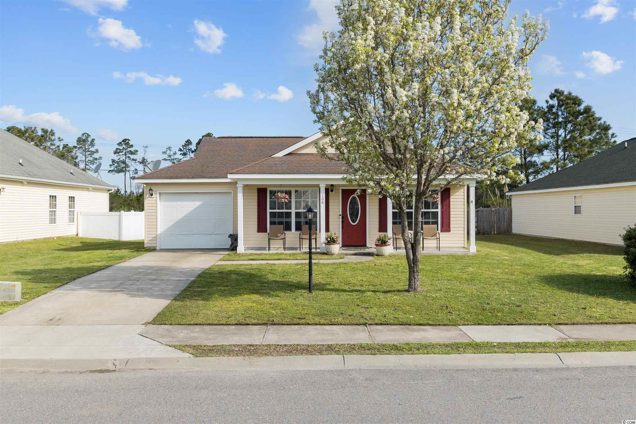 The location of this house doesn't get much better! Located just 1.3 miles to the North Myrtle Beach sports complex and Highway 31 makes this no HOA community a perfect gem. The cute front porch is so welcoming and perfect for a set of rocking chairs. As you enter the home, you'll immediately notice the beautiful new floors throughout the whole home and tile featured in the wet areas. High vaulted ceilings in the living room and dining room makes it feel spacious and open. New fencing has been installed along the back of the property. This amazing floor plan offers 3 nice size bedrooms. The master bedroom opens up the the back deck and filled with so much natural sunlight. Dont miss the opportunity of calling this beautiful bright and airy house your home.
