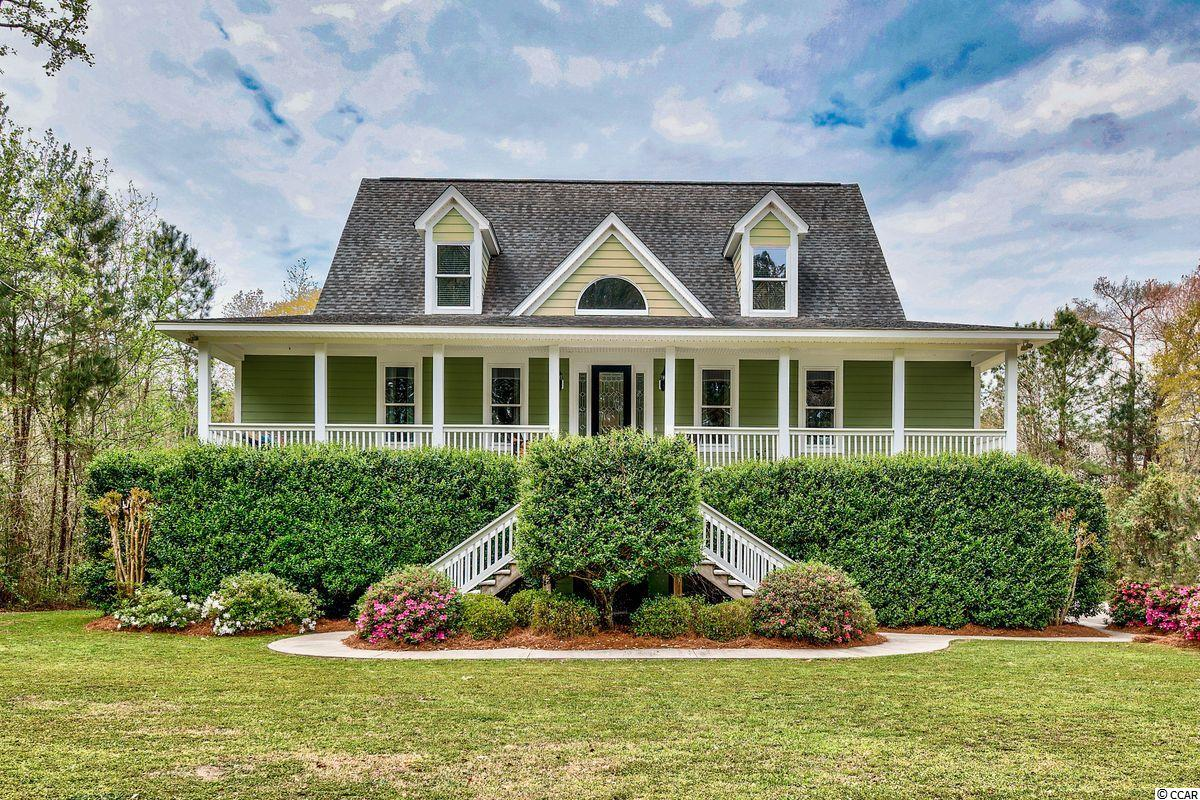 This riverfront home is located on the grounds of the former Deer Hall Plantation on the Black River. This house was built for a family that loves the water and was inspired by the Charleston low country vernacular. The owners customized this home to enhance the amazing water views.  Among the many features of this dwelling is the layout designed to enhance the entertainment of family and friends. The expansive chef's kitchen will most certainly meet all of your expectations The master suite affords all the privacy you'll need and includes a  sitting area with river views. This 3 bedroom and 3-2 half bath home is perfect for a medium to large sized family. Inside features include a formal dining room, custom kitchen, living room, and breakfast room. Outdoor entertainment and living will be enjoyed day and night with a screen porch providing tranquil views of the Black River. The beautiful cypress marsh walkway will connect to your personal dock.  This home is located in an outstanding neighborhood with a private boat access for larger boats if you so desire. The location is excellent as it is just minutes from historic Georgetown.