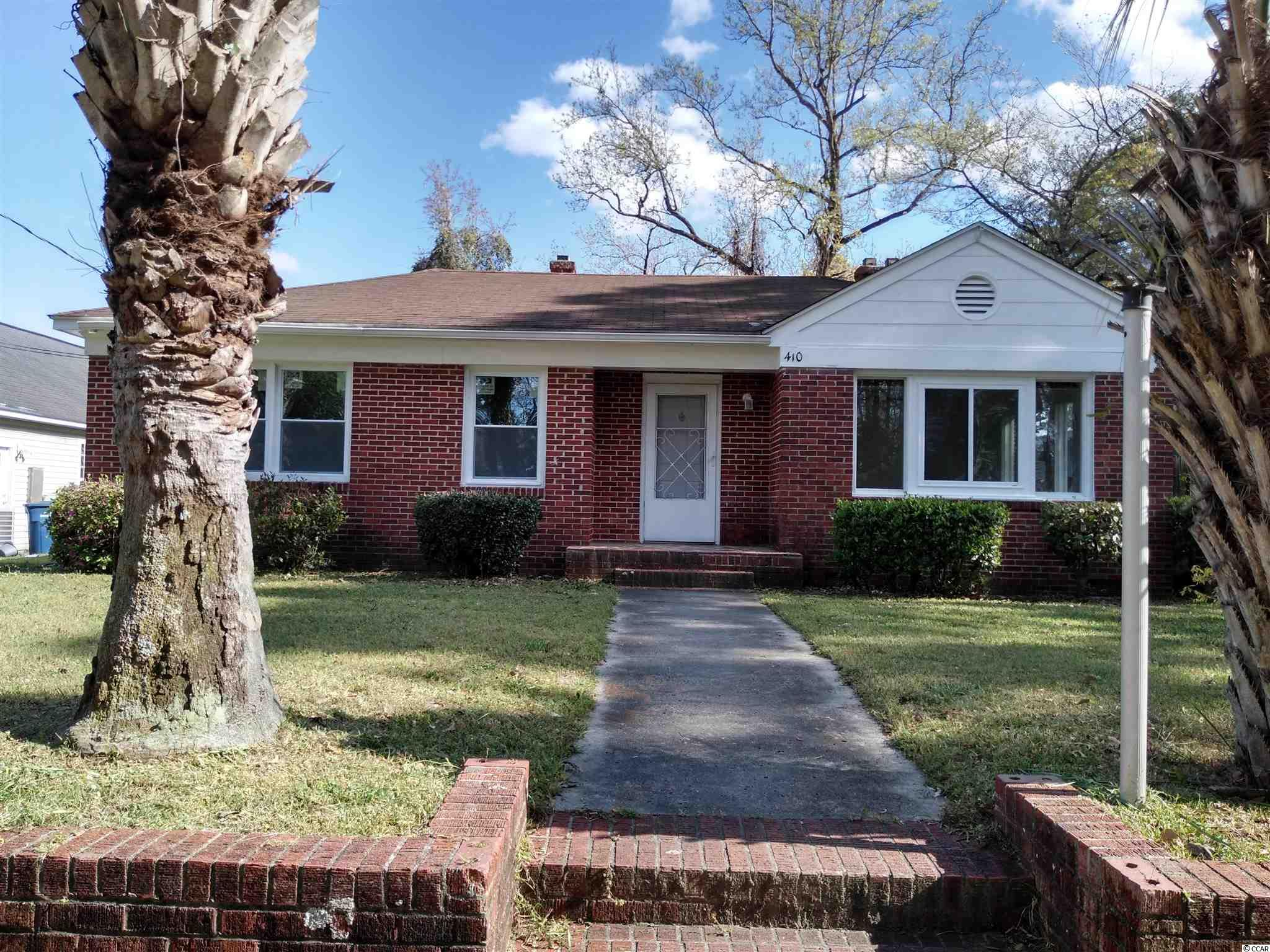 """This is on the high land's all brick home is located in the heart of Myrtle Beach close to the ocean, 10 minutes walk to the beach. Also close to the shops, restaurants and schools near HWY 501  and 17 business. Across the street is children's playground.  No HOA. There are 4 bedrooms ,2 bathroom, and large flexible room have enough windows for natural light into the rooms and get natural scenery. The New AC installed in 2020.  The new floor just finished the installation. You can still smell the fresh paint on new walls. The screen is big enough for a small family to enjoy the breeze overlooking at large back yard. The property sold """"as it"""""""