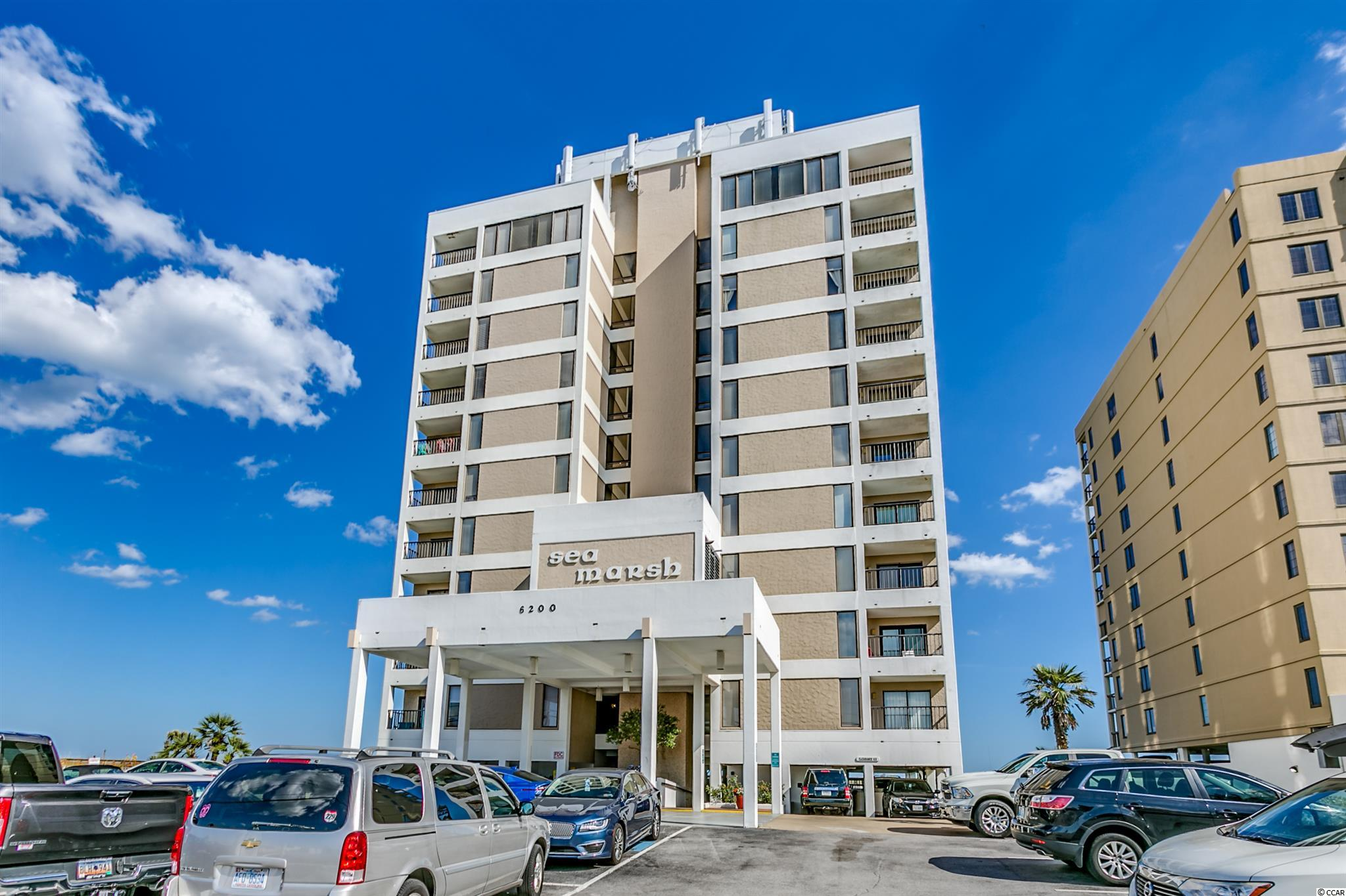 Don't miss this rare opportunity to own an end unit at one of Cherry Grove's most popular complexes!  This is not your typical beach condo and has been lovingly renovated and styled as a second home.  You will find upgrades throughout this three bedroom, three bath condo as Sea Marsh 1.  As you enter the unit a calming turquoise color scheme instantly puts you in a coastal mood.  Luxury vinyl plank flooring has been installed in the living areas in a wide plank, washed wood look. An updated kitchen with gleaming white newer cabinetry and stainless appliances allows for you to prepare meals for family or guests.  The kitchen opens into the large living and dining area to make the perfect gathering place.  Large sliders open onto the oceanfront deck to enjoy the beautiful Atlantic Ocean views.  The sliders were recently replaced in 2019.  The view is even better with the end unit location and nothing is obstructing the view to the south down the coast line. Side windows also allow in plenty of light into the condo.  Heavy white crown molding also adds a custom tailored look to the living space.   You will find the master suite at the end of the hallway and it is truly an owners getaway complete with a private bath.  A small balcony with access from the bedroom provides a fantastic view of the Cherry Grove marsh.  Two other hall bedrooms allow for guest or family use.  The condo has been styled in a sophisticated coastal theme and comes fully furnished with all appliances and decor, minus some exclusions.  All furnishings are high quality and appear like new with very little wear.  Other upgrades in this condo include fresh paint in 2019 with smooth ceilings, upgraded plumbing fixtures and lighting, new HVAC in 2020 and recessed lighting.  This condo is turnkey and ready for new owners to enjoy!   Sea Marsh 1 is an extremely popular complex with a prime Cherry Grove location adjacent to the inlet. Units do not come available often. Outdoor pool with paver patio and bea