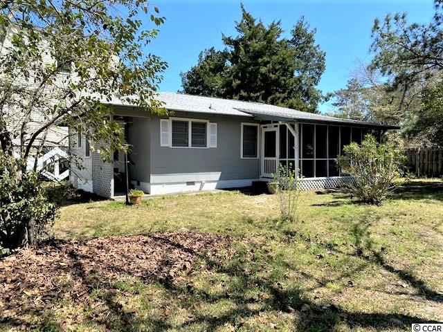 Charming 3 bedroom, 2 bath home east of Hwy 17 in the Windy Hill section of North Myrtle Beach.  This home has been cherished by three generations of family and is ready for its new owner to love.  Situated in a private setting, the shady yard provides room to play.  The kitchen is open to the dining area and adjacent to a large living room.  Bedroom one and two are connected by a convenient jack and jill bath.  A third bedroom provides privacy, and there's another full bath off the kitchen. Partially furnished.  Enjoy afternoons smelling salt air on your screened porch this summer!   Call for your showing today!