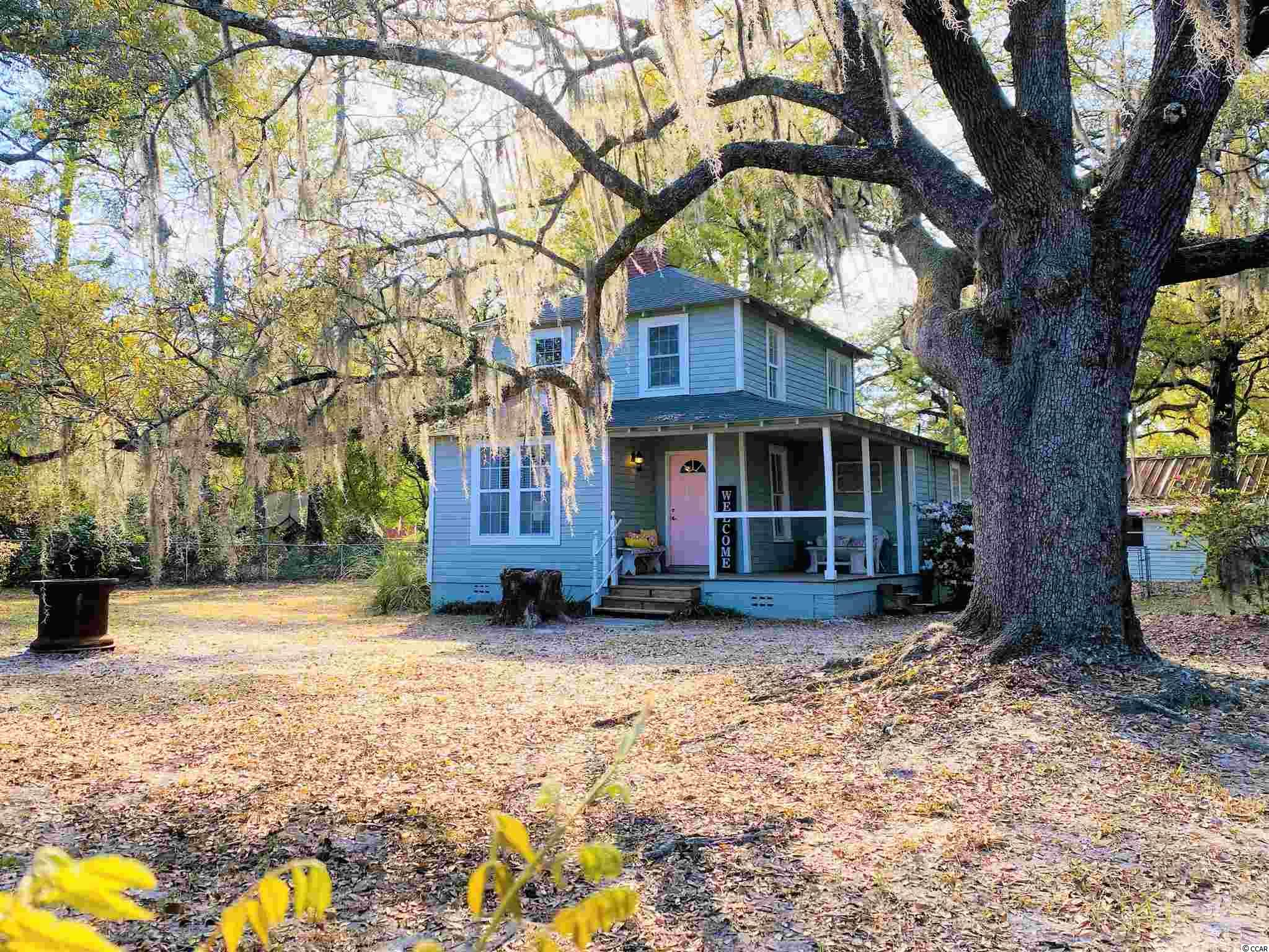 "2218 Old Charleston Rd. in historic Georgetown, South Carolina!  This quaint home is the original farm house that was once part of a twelve acre tract known as ""Owens Farm"".  Built in 1922 with hand hewn timber and surrounded by amazing live oak trees.  Rumor has it that ""back in the day"" there were so many oaks the children could climb from one tree to the next without touching the ground!  There was also once a mercantile on the corner that was possibly the last stop on the way to Charleston - interesting to know little bits of history!  The home has three bedrooms with the owner's suite being down stairs and one bathroom that has been recently renovated. The cozy great room has hardwood floors and an old fireplace, and there is a country kitchen with new stainless appliances and a formal dining room area. Cute front porch, just under half acre lot and partially fenced yard with azaleas, camelias, and wisteria. Detached workshop with an adjacent music studio/rec room and plenty of room for expanding the home if needed.  Priced to sell ""as is"" and waiting on a little restoration/TLC and maybe even a tin roof - just sayin'.  Close to historic downtown Georgetown and the Harbor Walk shops and wonderful restaurants, easy access to salt or fresh water boat launches where you can go out and enjoy any number of boating and fishing opportunities. *Buyer is responsible for verifying square footage."