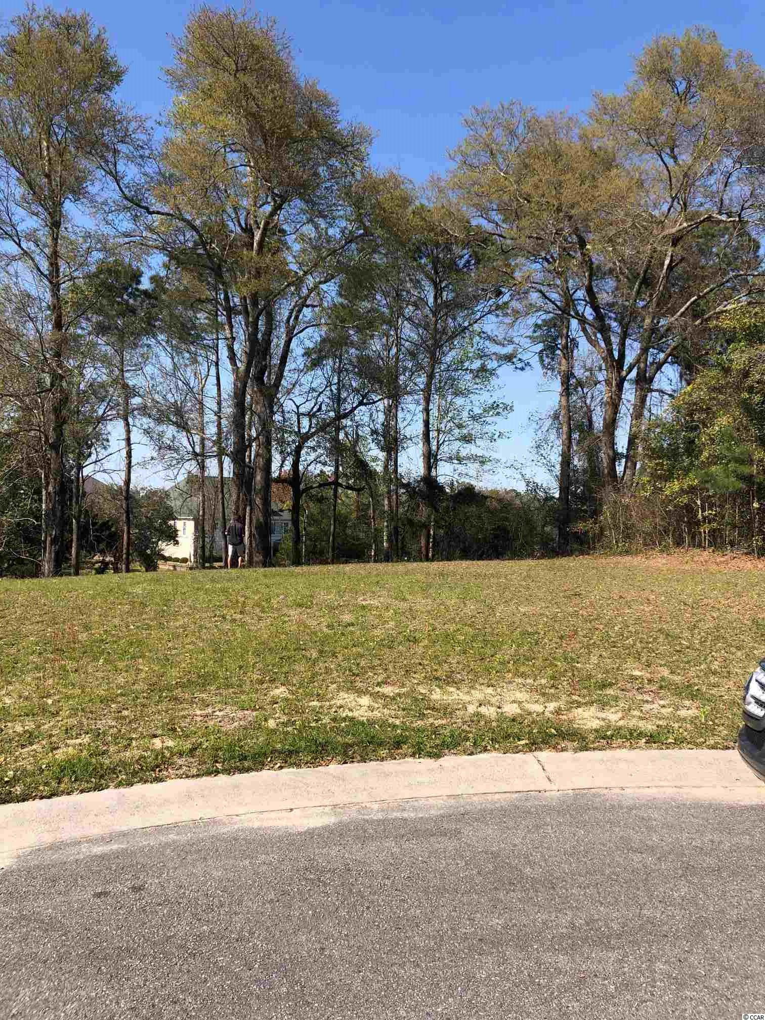 One of the highest points in NMB. Private Cul-de-sac lot on the lake, tucked away residential lot in a great neighborhood east of 17 in North Myrtle Beach. This wooded lot is a good size (.44ACRE) with a pond view, close to the beach, waterway and all of the area amenities. Golf cart distance to the beach. When you build your house, you may be able to see the intercoastal waterway from the first raise floor.