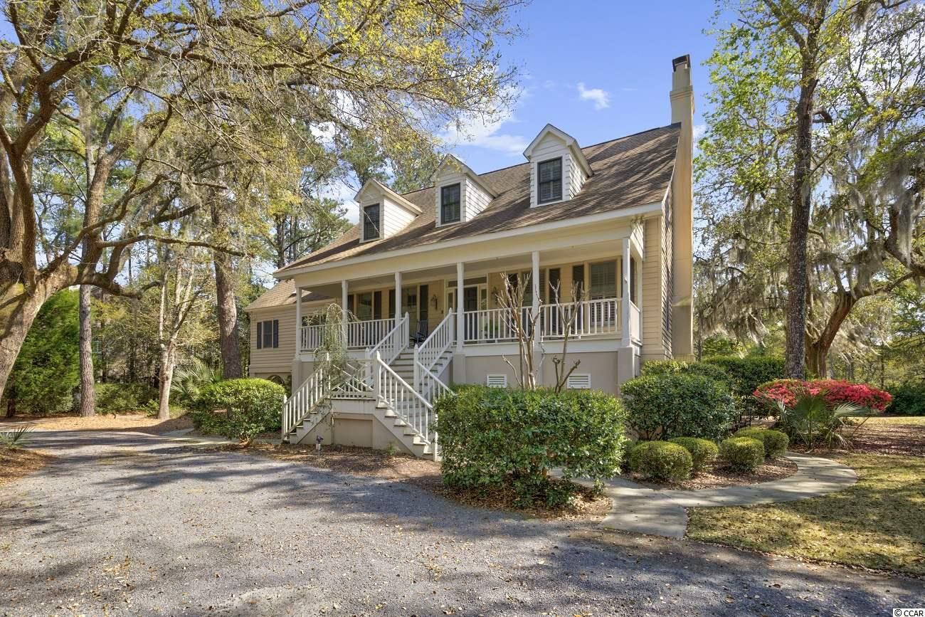 Gracious Southern Living on a lovely lake framed by moss draped live oaks in the heart of DeBordieu Colony, this beautiful 5 Bedroom Lowcountry home with an elevator is just a short golf cart ride to the beach, golf, tennis, dining, and more. As you enter the foyer from the welcoming front porch, the formal dining room with a door to the kitchen is to the left, the expansive living room with built in cabinetry and a gas fireplace is to the right. Gorgeous hard wood floors, crown moulding, and beautiful built-ins immediately reveal the quality with which this home was built. The kitchen, its cozy keeping room, and breakfast area all overlook the serene lake, as does the screened porch. The spacious master suite on the main living level, offers a walk-in closet, double sink vanity, large whirlpool tub and a sitting area with a bay window overlooking the lake. Upstairs are 3 guest rooms and a den/office. In addition to the garage and ample storage, the ground floor features a sizable apartment with a separate entrance, full kitchen and large living room with fireplace. Features Include: Elevator, 3759 Heated Sq. Ft., 6422 Sq. Ft. Under Roof. DeBordieu Colony is an oceanfront community located just south of Pawleys Island, South Carolina featuring private golf and tennis, saltwater creek access to the ocean, a manned security gate, and luxury homes and villas surrounded by thousands of acres of wildlife and nature preserves. People who know DeBordieu Colony say there will never be another place quite like it. Come see for yourself!