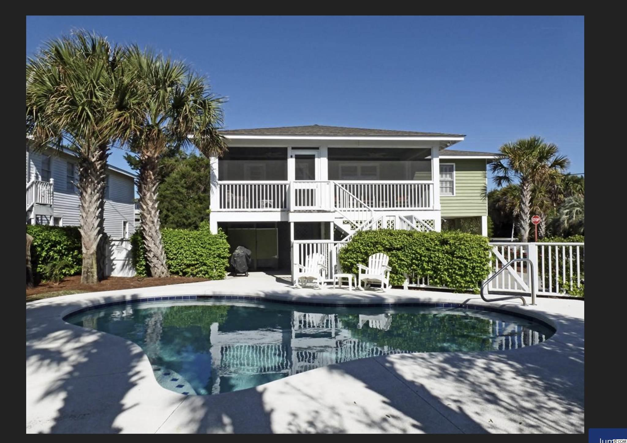 Charming beach cottage in Litchfield.  Steps away from beach access.  Sit on back screened porch overlooking the pool and experience ocean breezes.  This cottage has old beach house charm but with refreshed and recent renovations.  New bedroom and full bath added on ground floor.  Along with laundry nook and internal stairwell.  Small boat landing is also steps away perfect for launching kayaks and johnboats.  Picnic table and outdoor shower downstairs with plenty of parking.