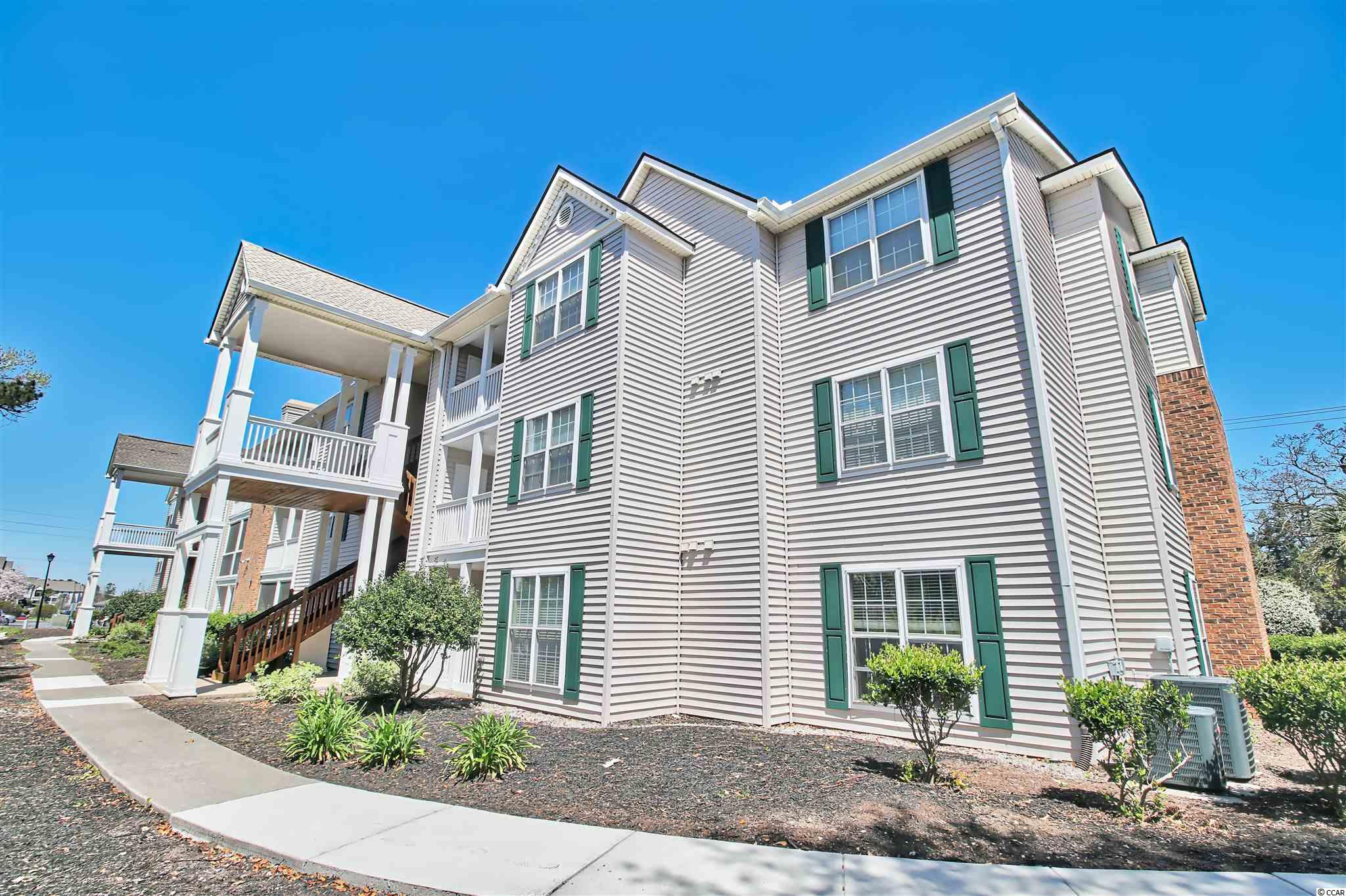 You will not want to miss this well maintained 3br/2b unit that just became available.  Location is everything and this unit happens to be in a centrally located, golf cart or walk to the beach, condo community, Broadway Station.  This 2nd floor unit, has a living room/dining room combo, both with crown molding. The dining room has armchair railing.  Ceiling fan in living room and sliders from the living room that access the screened in balcony with its own storage closet.  The galley style kitchen has all the modern conveniences:  smooth top range, with over range microwave, dishwasher, double sink with garbage disposal, refrigerator, and country pantry cabinet.  Laundry room is deep with washer and dryer and shelving.  Master bedroom has ceiling fan and access to the screen balcony, and walk in closet.  The master bath has a garden tub/shower combo.  The two guest bedrooms are large, one having a walk in closet and the other having two closets.  Hall bath has a shower/tub combo.  Broadway Station is a gated community, with a resort style pool with lake views, hot tub, club house, fitness center, a car wash, and gas grilling stations throughout.  Broadway Station is located less than a mile to beach, and convenient to dining, shopping, groceries, medical facilities, golf, and entertainment, including the nearby Broadway Station, Myrtlewood golf courses, and TopGolf.  This is a must see!