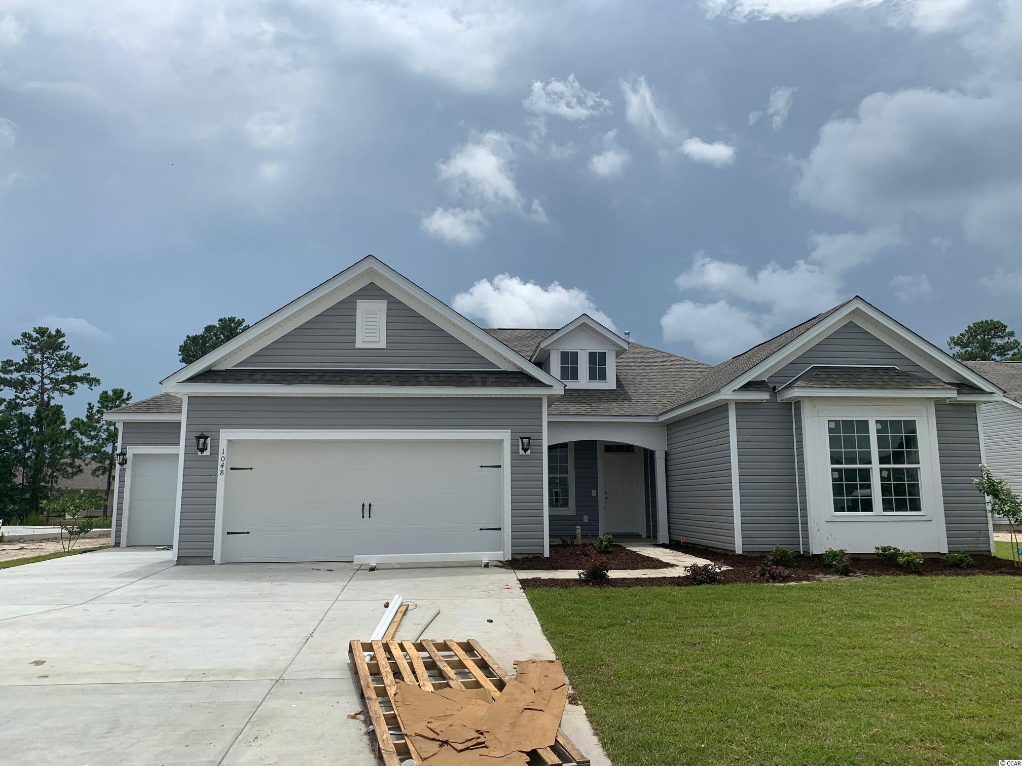 """3-CAR GARAGE, COVERED PORCH, WATER VIEW, BRAND NEW!  This popular """"Reynolds"""" home features 3 bedrooms, 2.5 baths, a 32ft covered porch with a marvelous water view, an open concept design, larger bedrooms, a 3-car garage, upgraded-included features, and more!  The Kitchen is a real showstopper with crisp white 42"""" Master Brand cabinets, Osprey Granite countertops, a spacious angled Kitchen Island illuminated with Progress Lighting Staunton pendant lights in brushed nickel, Daltile Grey Glossy tile backsplash, and Whirlpool Stainless Steel Kitchen appliances (side-by-side refrigerator, natural gas range, over-the-range microwave vented to the exterior, and dishwasher).  Easy living at the beach is enhanced with the durable, low maintenance Mohawk REV Wood flooring in the living areas and Primary bedroom, and Daltile flooring in all baths and the laundry room.  The generous Primary bedroom boasts a tray ceiling, a walk-in tiled spa shower with a rain showerhead and wall showerhead, double vanities, a water closet, and a spacious walk-in closet.  Additional thoughtful attributes include a vaulted ceiling in the Great room, a designer trim package, a tray ceiling in the Dining room, faux wood blinds throughout, a lawn irrigation system, a fully sodded homesite with foundation trees and shrubs, a natural gas tankless Rinnai water heater, Moen plumbing fixtures throughout, and Sherwin Williams Agreeable Gray interior wall paint with white ceilings.  This Energy Star Certified home provides comfort at a lower cost.  The Belle Mer community offers amenities galore: community pool, clubhouse with a gathering room, catering kitchen, and exercise room, fishing and non-motorized boating lakes, sidewalks, and a premier location; just a bicycle ride to the beach.  *Disclosure: Photos are of a similar Reynolds home with some different features."""