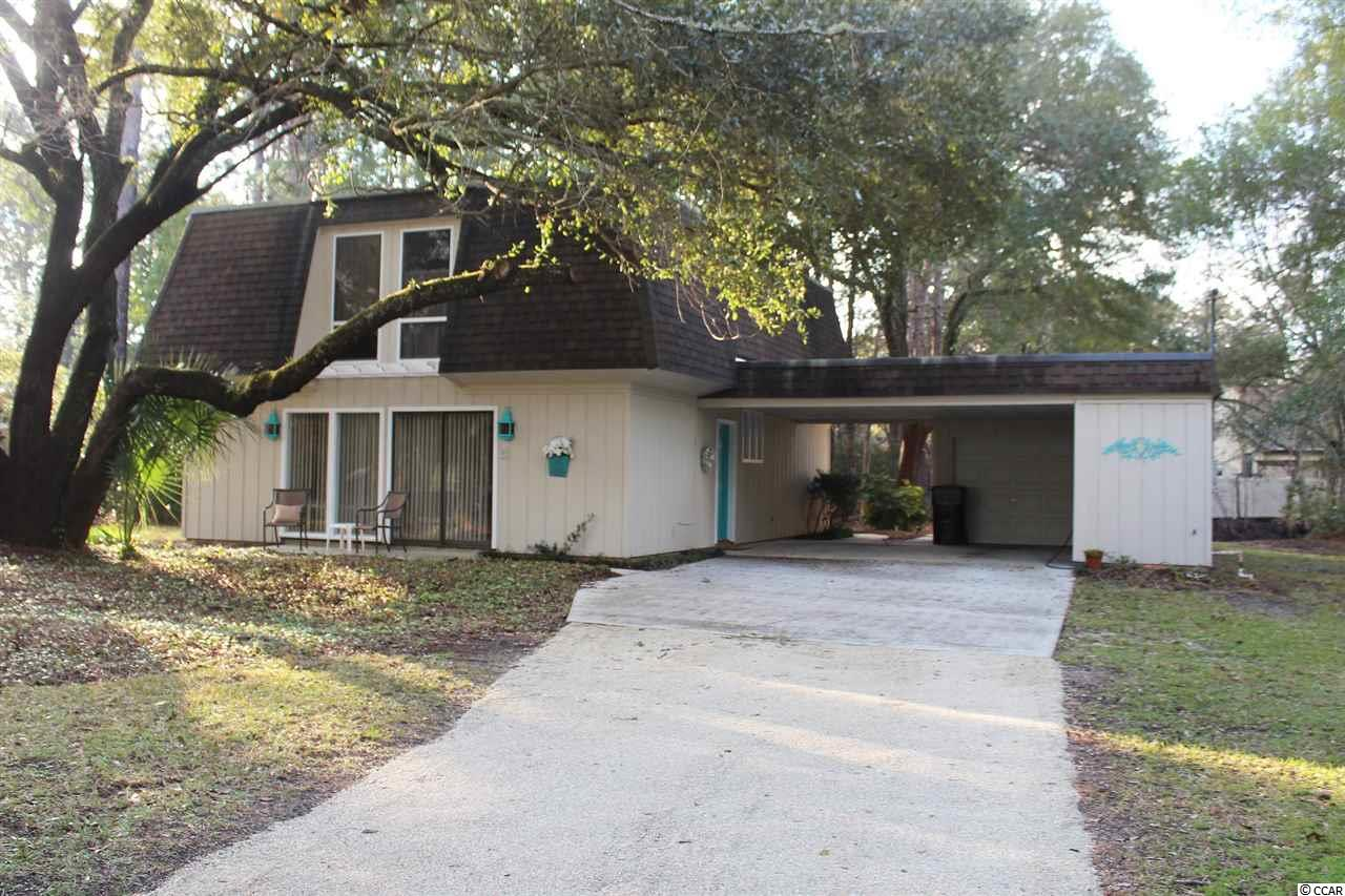 Beautiful location in Litchfield Country Club. This home is perfect for a primary or second home at the beach. There are lots of windows making this home bright and cheerful with garden views. The main floor has living area, dining area, kitchen with walk-in pantry, family room, a half bath plus 2 patios for outdoor living space. ALL 3 BEDROOMS ARE UPSTAIRS, with 2 BATHS. The large master bedroom opens to a balcony overlooking the backyard. There is a carport and attached workshop/small garage with plenty of storage for kayaks, bikes, and jon boat. This home is set up for life at the beach and is convenient to the Litchfield and North Litchfield Beaches, grocery stores, shopping and restaurants.  Myrtle Beach is 25 miles North, and historic Georgetown is 15 miles South.