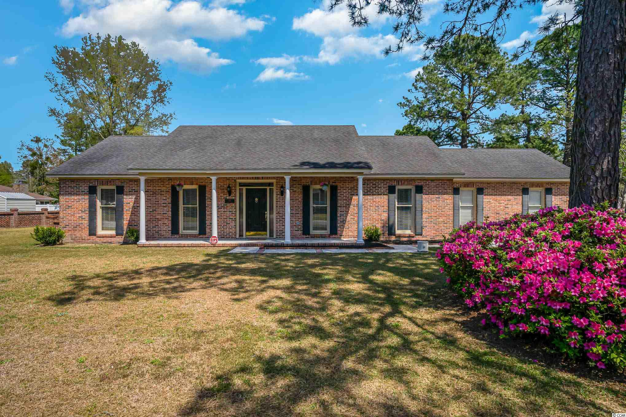 Get your sweet tea and rockers ready for the front porch of this beautiful brick home in the desirable Coastal Heights!  This home is situated on a large corner lot and is within walking distance to Coastal Carolina University and Conway Medical Center.  Enjoy the large back porch and fire pit in the brick fenced backyard.  There is a bonus heated and air conditioned room upstairs.  9 ft ceilings and wainscoting throughout the dining room and hallway.  Some furniture is negotiable.  Kitchen appliances and Washer/Dryer convey with the home.  Chandelier in the dining room does not stay.  Don't delay, this home will go quick!  Schedule a showing today!