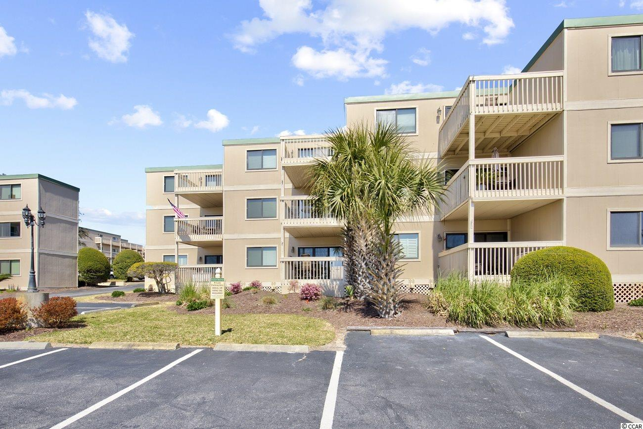 OCEAN VIEW, AMAZING OPPORTUNITY! Same owner for 17 years, has not been on a rental management program enjoyed by family and friends!  Fully furnished 2 bed, 2 bath condo just steps from the beach! This first floor, handicap accessible Ocean Bridge unit is suitable for full time living, a second home, or investment property. Enter through the foyer into an open living and dining room. This completely updated unit is  the only one in the complex with an open kitchen with granite counters, stainless steel appliances, and a breakfast bar. Off the kitchen is also a laundry nook providing you with in-unit laundry. The two bedrooms of this condo are split on either side of the living space, providing you and your guests with lots of privacy. The spacious master bedroom comes complete with upgraded hardwood floors and an ensuite bathroom. This unit also has a private spacious balcony perfect for outdoor living and enjoying the ocean breeze. Located on the second row from the beach, Ocean Bridge is ideally situated in one of the most desirable sections of Myrtle Beach close to all the best shopping, dining, and entertainment! This is an opportunity you don't want to miss!