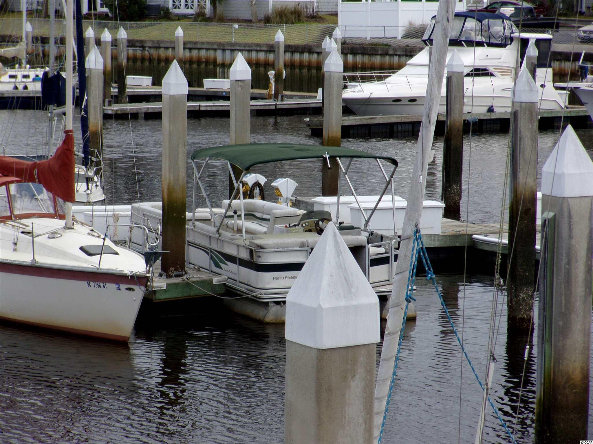 30' boat slip on the Little River Inlet! Dock Locker, Electricity and Water at each floating slip. Clubhouse with bar open 5 days a week, includes showers, year round pool and spa. The property is located in a gated and protected area with secure dock area. SQUARE FOOTAGE IS APPROXIMATE AND NOT GUARANTEED. BUYER IS RESPONSIBLE FOR VERIFICATION.