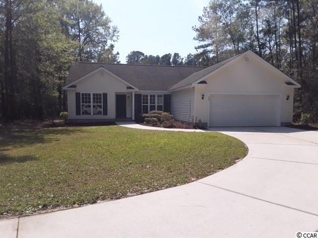 ***one full acre tucked away on the lake in the serene and secluded  Pawleys Retreat community; *** open floor plan complementing the integrated formal dining area, kitchen, breakfast nook, living room (with gas fireplace) and Carolina room, with adjacent screen porch;  *** dishwasher, new refrigerator, new gas range and new microwave;   *** Master Bath has dual basin sinks, walk in closet, shower and genuine Jacuzzi tub;  *** new 18 SEER HVAC System and new Water Heater;   ***Security System and independent Irrigation system.