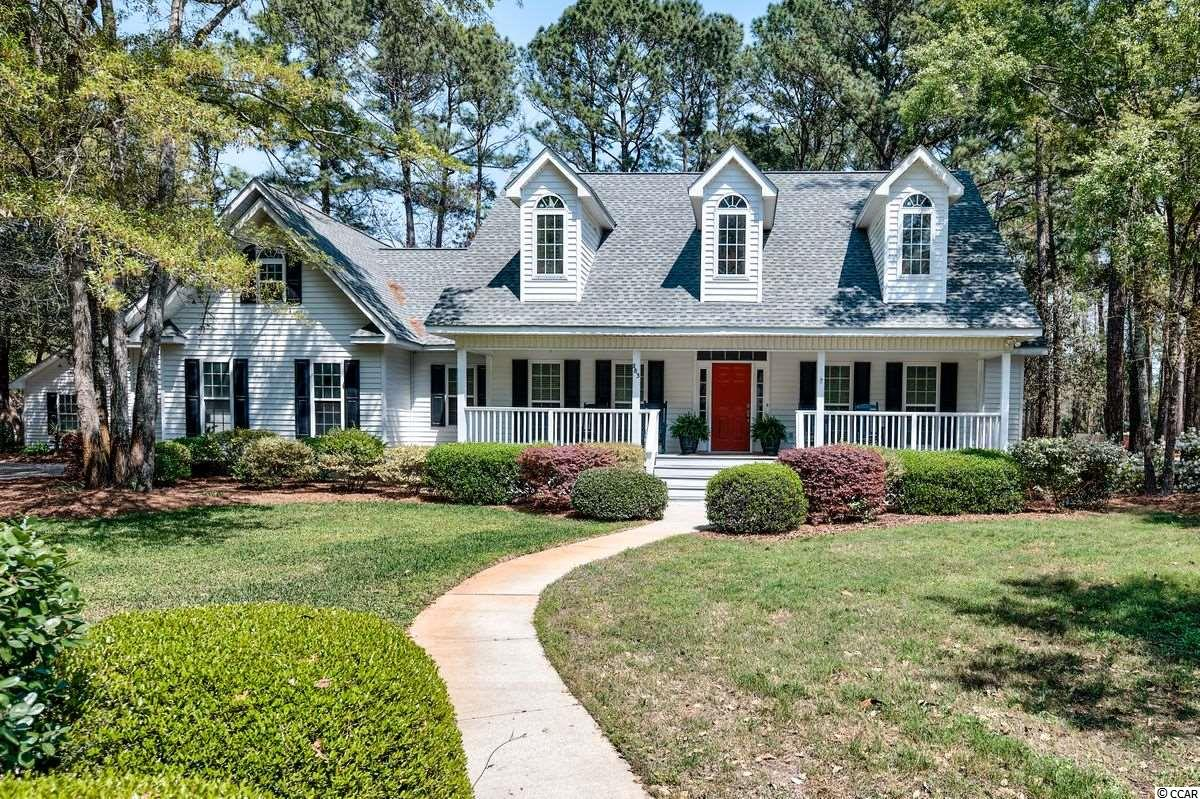 """Welcome to 283 Linden Circle. A beautifully maintained, low country home on a large corner lot. With two separate garages, there is room to park all your cars, golf carts and boats. Front and back porches offer peaceful places to kick back in a rocking chair and enjoy the peace and quiet you need to relax. The family room has a tall vaulted ceiling, fireplace with gas logs, French doors leading to the back deck and an open concept layout right next to the kitchen. Kitchen features a 40"""" x 89"""" charcoal gray granite island matching all of the kitchen countertops as well as a new refrigerator and double ovens. You can pull a bar stool up to the island, eat at the breakfast table that overlooks the back deck or enjoy a family meal in the formal dining room. The large  Master bedroom is steps away from the kitchen. It features a tray ceiling and plenty of natural light. The gorgeous Math Bath has been recently renovated with a freestanding soaking tub, custom clear glass shower with marble tile and rain shower head as well as a hand held shower head. Double vanity with solid white stone counters, separate potty room, marble floor tile and walk in master closet complete this wonderful room. 3 bedrooms are on the opposite side of the home and share a bathroom. There is a separate laundry room. Huge bonus room over the garage with fresh, new carpet. Hardwood floors are in the main living areas of the home. Home has programmable thermostats. The crawlspace has been encapsulated. Lot is approximately one acre and HOA is voluntary. Litchfield Country Club is a well established, friendly neighborhood to come home to.  Plenty of wonderful beaches, salt creeks, rivers, golf courses, restaurants, great schools, shopping and art boutiques as well as friendly neighbors are part of what makes Pawleys Island such a special place to live.  Myrtle Beach is 30 miles north of Pawleys Island. Charleston is 60 miles south of Pawleys Island. 283 Linden Circle won't last long. Take a look and"""