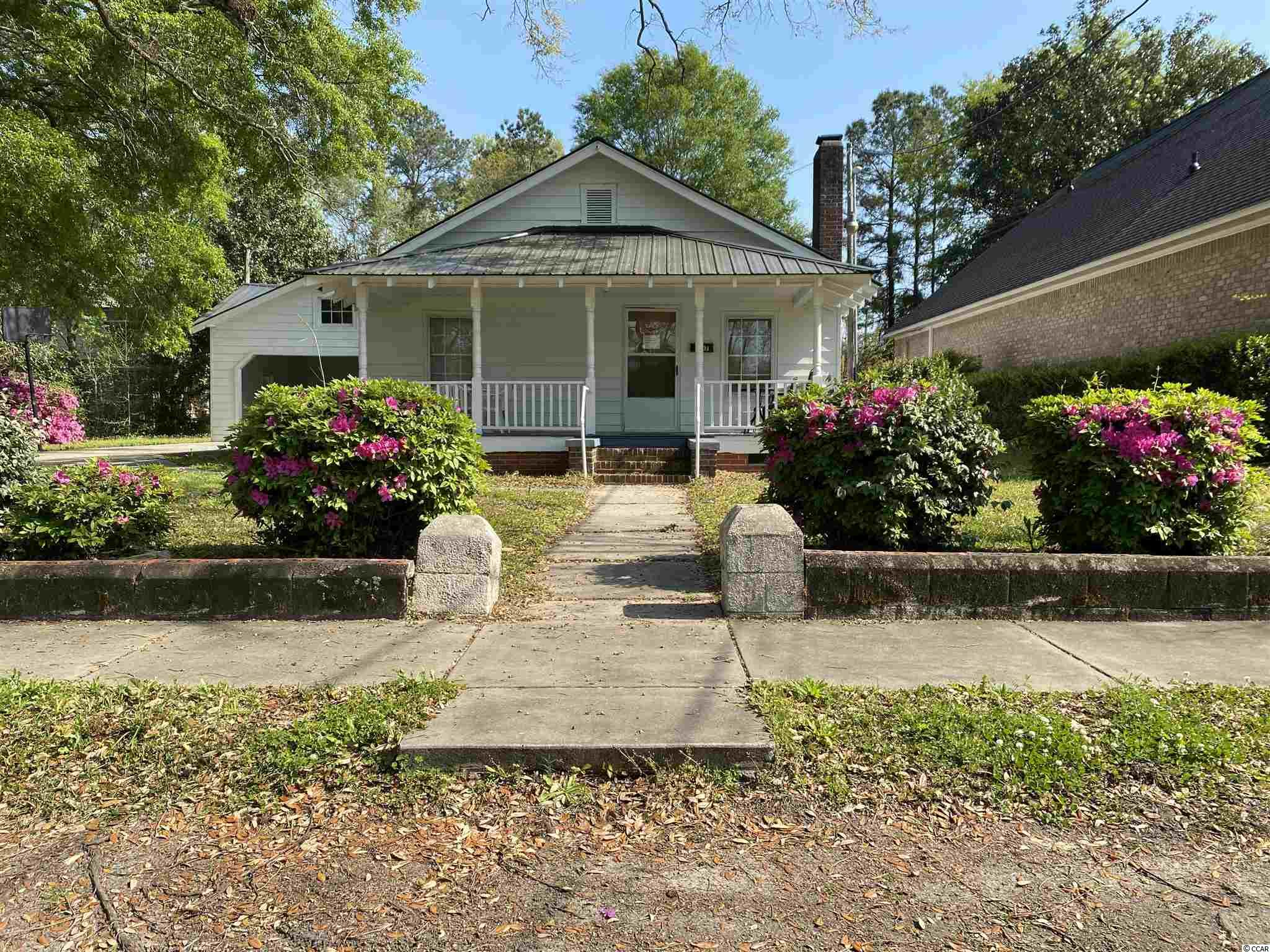 Great opportunity in downtown Conway close to Court House. Ideal for Attorneys office, multi-rental office building. House on property is rented month to month.