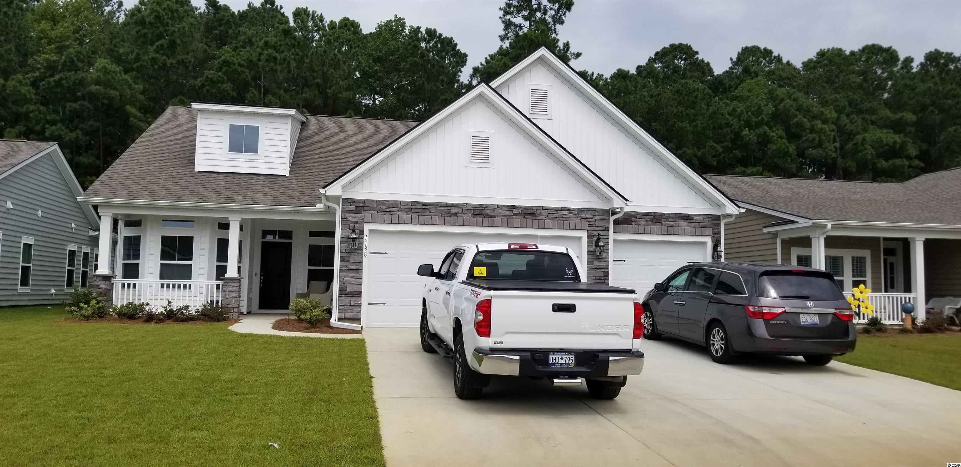 "This Lexington plan has 3 car garage and is located on a beautiful large pond. THIS HOME WILL BE MOVE READY MID JULY 2021...It features an upgraded kitchen with huge island and breakfast nook which overlooks the open great room and a separate office/flex room .  Included in this home is a Home Automation system, WIFI Certified and lots of Smart Home features, laminate floors, granite counters  42'""staggered cabinets and GE stainless appliances. Forestbrook Estates is a natural gas community which  offers an amenity including pool, cabana and community garden.  Situated in the Forestbrook area of Myrtle Beach, you are literally minutes to the beaches, shopping, dining and theaters.     **Photos are of our Lexington model home and includes upgraded features."