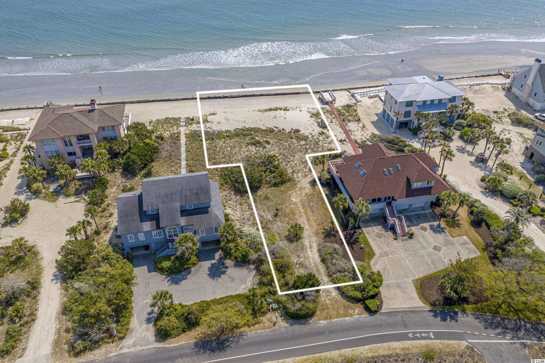 Amazing opportunity to build your very own Trophy Estate on this Direct Ocean Front lot in the highly sought after gated community of DeBordieu Colony ! Lot 3 DeBordieu Blvd offers almost 100 ft. of breathtaking direct ocean front views ! Truly a rare occasion to purchase one of DeBordieu's last ocean front lots. Enjoy 6.5 miles of private and beautiful beach. DeBordieu community amenities include: private golf, beach club villa, golf clubhouse, tennis courts, & North Inlet Creek access. Just a short day trip away to historic Charleston or you can head up to all the attractions of Myrtle Beach. Close to boutique shopping and dining in Pawleys Island. This would be the perfect opportunity for your very own vacation home or permanent residence. Contact the listing agent today for more information and to schedule a viewing !