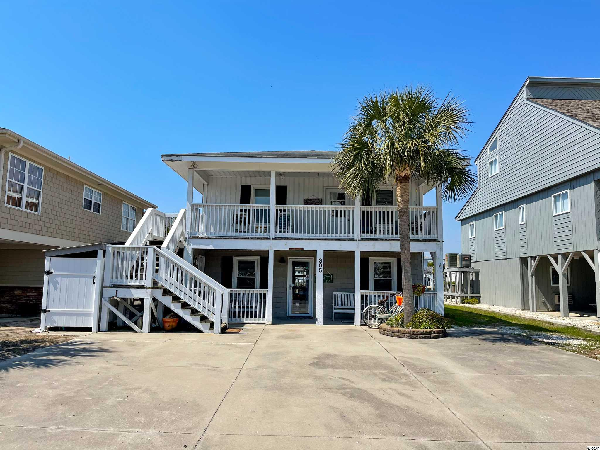 Located in walking distance ,only one and a half block away from the Ocean in Cherry Grove Beach ,SC. This Unique Raised Beach Home features two full stories, 3 bedrooms and 2 full baths on the first floor and 2 bedrooms and 2 baths on the second floor,2 full kitchens, living room and front and back porch / patio area on each level. The house is sited on the water channel with a private Boat ramp (very rare) and brand new Dock for all the entertainments, fishing ,kayaking or simply enjoying cup of coffee on it. A lot of updates have been made to this unique beach house: HVAC- 2020, Roof -2017;Water Heater-2020,New PVC wall, lifted electricity and brand new appliances on the first floor.  Great Investment Opportunity -the home is divided as a Duplex and has 2 separate entrances on both floors from the front and the back of the house. There are many options with this property to use the entire home with plenty of privacy for everyone to enjoy the Beach / Vacation lifestyle ,rent  both floors ,or use one level for personal use and rent the other level to cover the expenses.  Selling the home fully FURNISHED.