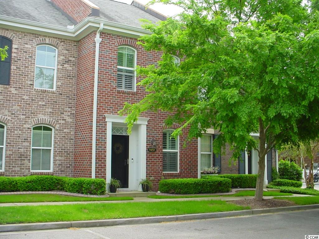 This quaint brick 2BR/2.5BA townhome is located in the heart of The Market Common just steps from all the regional, national & local retail, food and service facilities located in our lovely downtown. Park your car in the oversized (16x20) garage and forget about it .... The MC pool, Myrtle Beach State Park, grocery shopping, dog park, Grand Park & movie theatre is only a short walk or bike or golf cart ride away. The interior features include smooth finished 9' ceilings. The deluxe trim package includes crown molding, plantation blinds, wainscoting, wide hand scraped hardwood floors, satin nickel finished hardware with oval grips & granite counter tops. This former model home includes a new GE Slate stainless steel kitchen appliance package (2018), butcher block breakfast counter (2017), hot water heater (2017), washer & dryer (2019), Murphy bed (2018), storm doors front & rear, relaxing courtyard with Belgard pavers, detached finished garage with 2 4'x8' overhead storage bins plus attic storage. Partially furnished. Do yourself a favor and compare this home to similar MC townhomes and its livability/value become apparent. Call ASAP and take advantage this summer of all The Market Common has to offer.