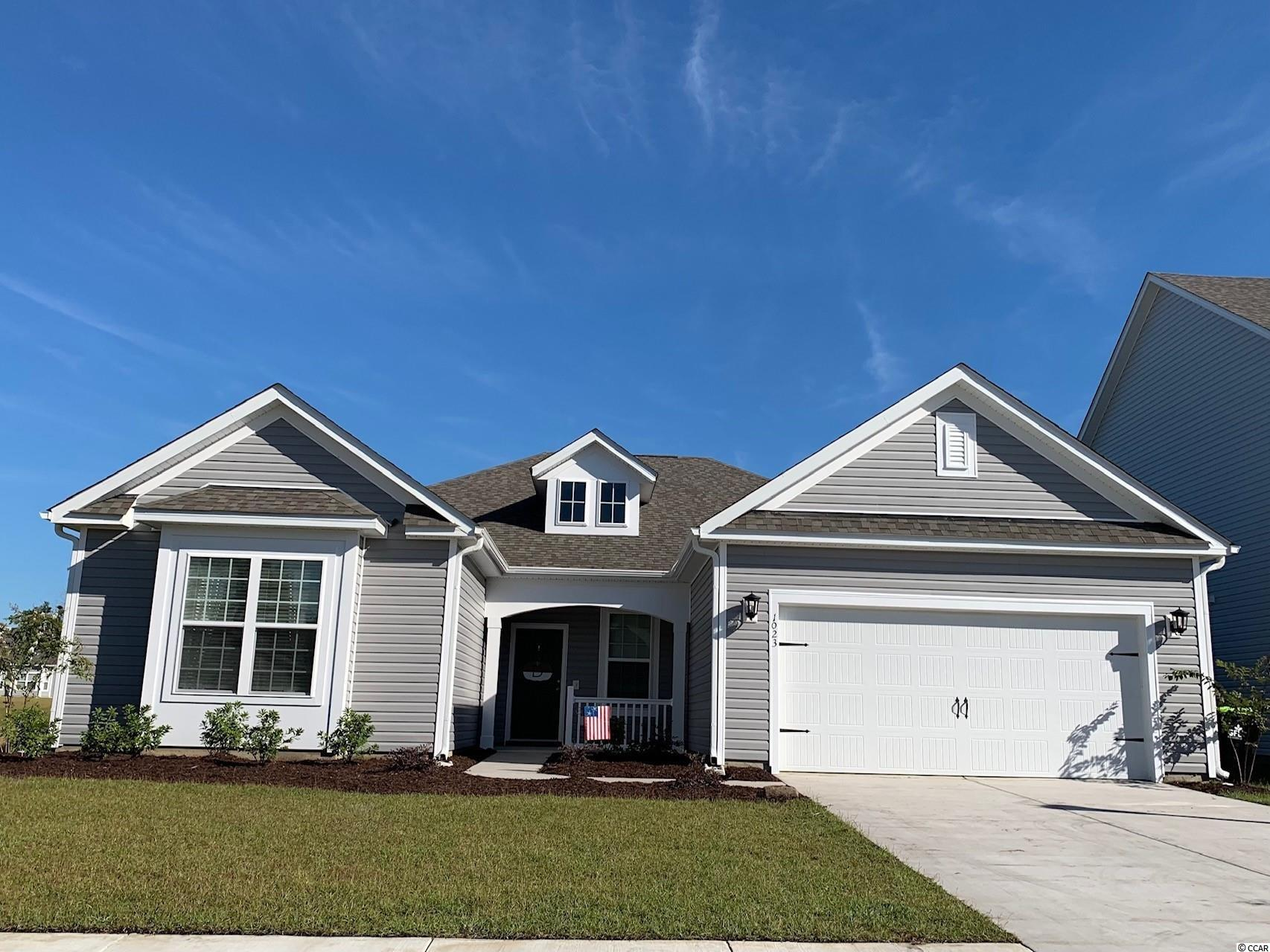 Waterfront! Reynolds-TRL features 3 bedrooms, 2.5 baths, a marvelous open concept design, a 32ft screened porch, and a lake front home site. The kitchen features stainless steel Whirlpool appliances, included refrigerator and laundry package, White shaker Master Brand cabinets, a waste basket drawer-cabinet, Quartz counter tops, and decorative Progress Lighting Glass Pendants over the Kitchen Island. Rev wood flooring throughout living areas and primary bedroom. Crown molding, chair rail and picture molding, and a Dining room tray ceiling were added to enhance the beauty of this well appointed home. The Great room is located off the kitchen. This marvelous Great room boasts a vaulted ceiling, and additional ceiling fan. The Primary Bedroom includes double doors that lead into the Primary Bath. The Primary Bath features a Daltile walk-in shower with Level 2 tile, a double vanity, and Brushed Nickel Moen bath plumbing fixtures. Other value-added features include: White faux wood blinds, Sherwin Williams Agreeable Gray wall paint and White ceiling paint, a tankless natural gas Rinnai Water Heater, gutters, irrigation, foundation trees, and shrubs. Belle Mer homes are Energy Star Certified creating amore comfortable home at a lower cost. Belle Mer amenities include weekly curbside trash collection, sidewalks, a community pool, and clubhouse with a catering kitchen, exercise room, and gathering hall. Belle Mer features a premier location; less than 3 miles to the beach, across the street from 2 large shopping and dining venues, 3-4 miles to Market Common, and a short drive to Murrells Inlet or Myrtle Beach. Pictures are of same floorplan, features can be different.   We are allowed to sell one more home for May.