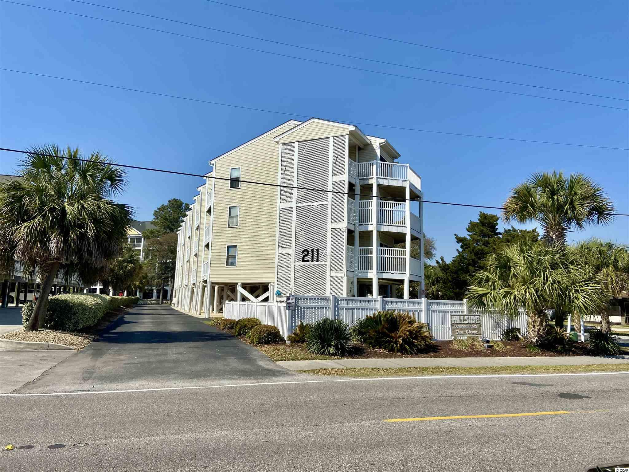 """Beautiful two bedroom, two bath condo located in the heart of North Myrtle Beach. This unit is in excellent condition and only a short walk to the beach! With balcony access in each bedroom and a large screened in porch on the front, there is ample outdoor space provided to enjoy the ocean air. Below the unit, there is plenty of under building parking and a nice pool. Inside the unit, you will see freshly painted walls and newer wood laminate flooring. Being sold furnished, this is a truly """"move-in-ready"""" unit!"""