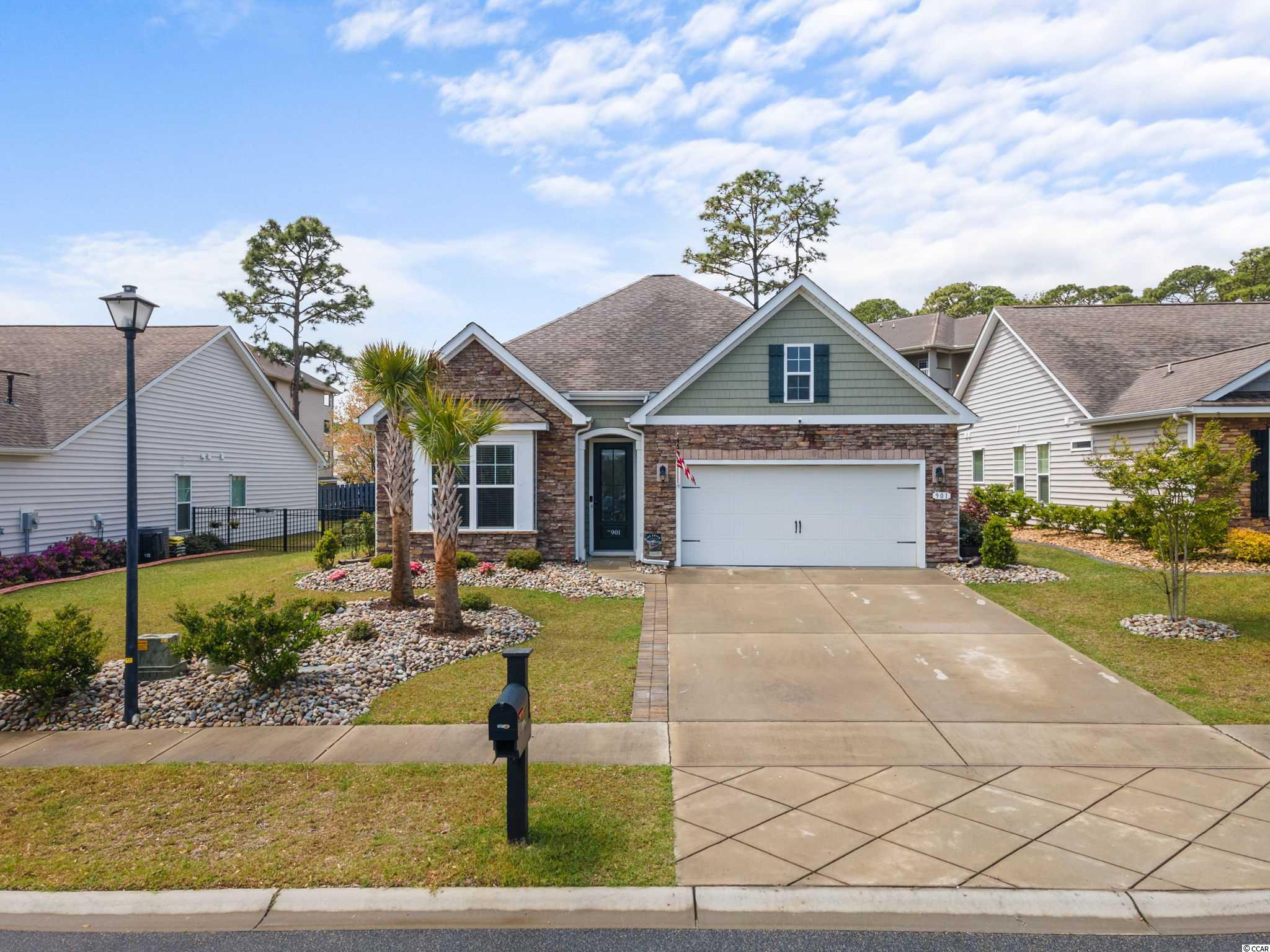 This immaculate 4br/2ba home is located in a small community close to shopping, dining, medical, and just a short golf cart ride to the beach. Only a few blocks from Main Street and the North Myrtle Beach Sports Complex where you will find many activities and entertainment year round. Enjoy the sunsets from the fenced backyard or enjoy those warm summer nights on the backyard screened porch. Solar power and natural gas helps to reduce the overall costs of electric. 9' smooth ceilings throughout. Other features include, LVP and wood plank tile floors, granite counter tops, beautifully landscaped yard, and pet door. Don't miss out on this one!