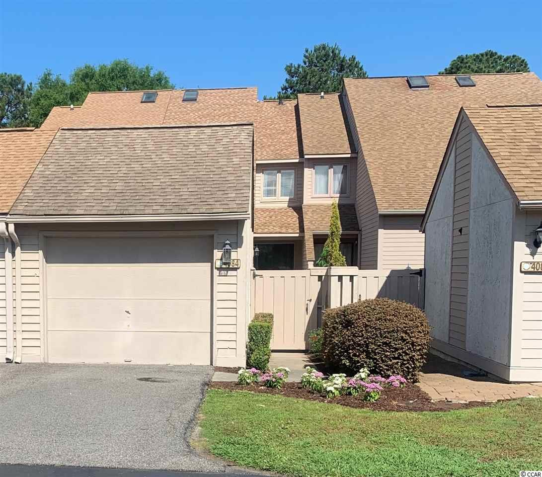 LOCATION, LOCATION. LOCATION!!!! Beautiful views of  the Golf Course, Waterway and Lake Views off both Balconies!!!….. This home has over 1800 Heated Sq Ft of Living Space and a 1 Car Detached Garage! This Huge TownHome has been updated with New flooring in Living Room and Dining Area. New Carpet in all the Bedrooms. Granite Counter Tops in the Kitchen, Granite and Tile in Bathrooms,  Master Bedroom on First Floor with a Master Bath. Upstairs are 2 Large Bedrooms and  2 Baths. Private Courtyard recently Landscaped with Fresh Greenery.  2 Brand New Carrier Air Conditioners, Painted through out Plus a New Roof Last Year! Subdivision offers a Pool and Tennis Courts and its  Located Close to Shopping Hospitals, Restaurants and Only minuets to THE BEACH!