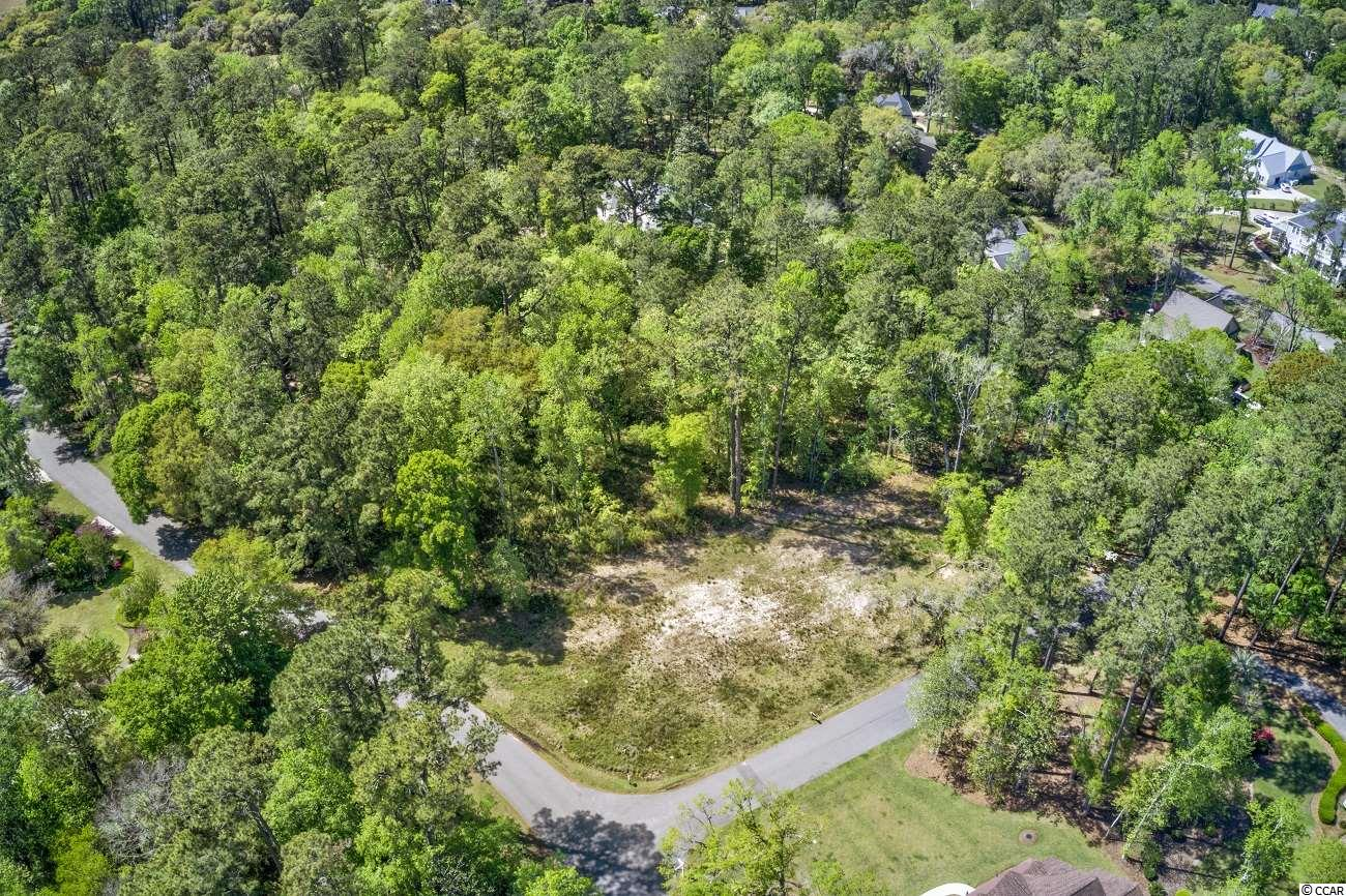 Already CLEARED corner lot in the heart of the highly desirable Litchfield Plantation.  As the new owner of this lot, you can finally build your dream home!  In addition, you will have access to a private oceanfront community beach house, a marina with access to the Waccamaw River, pool, and common area maintenance (which is stunning)!