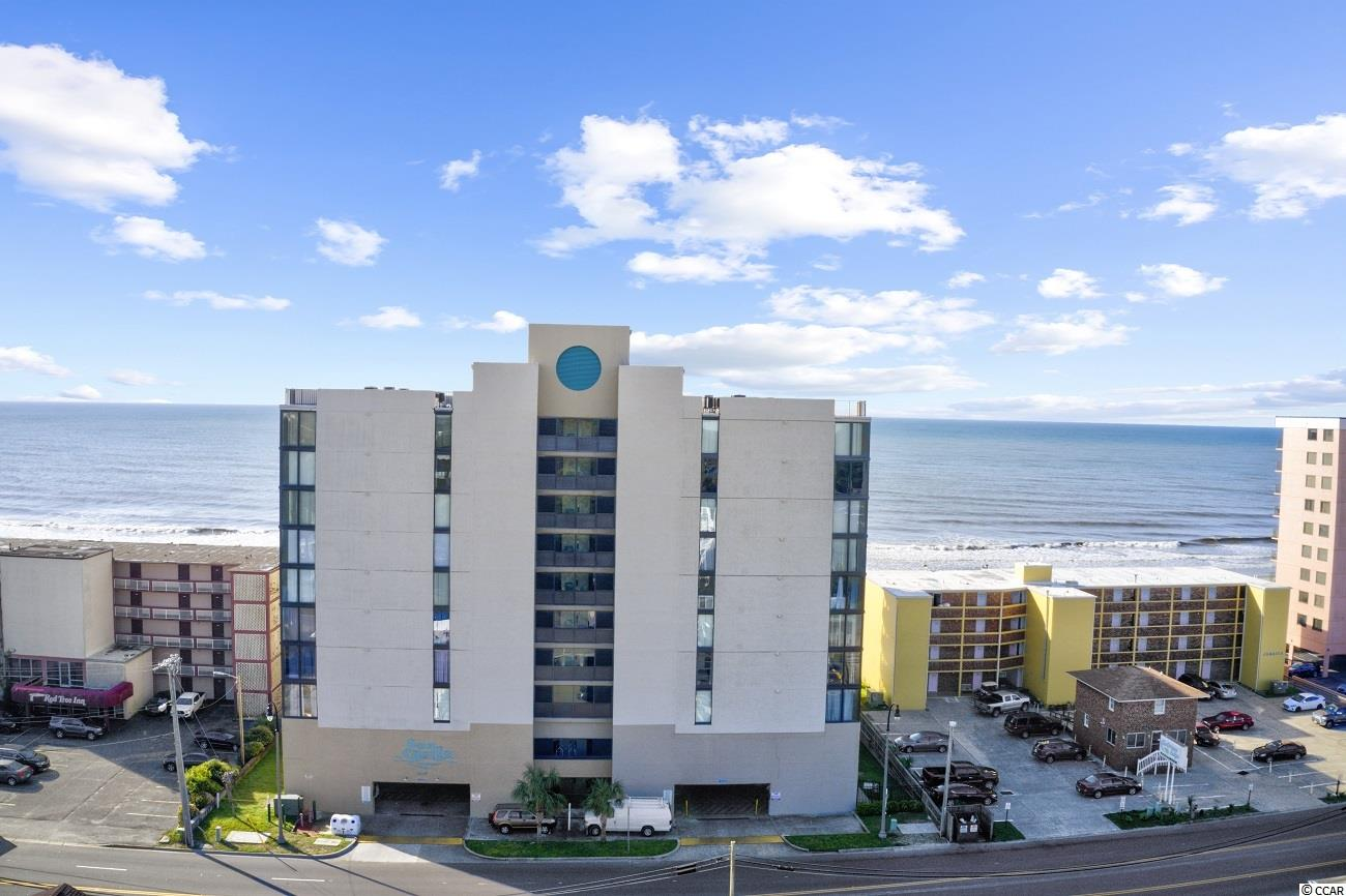 Absolutely stunning, full 180-degree views of the northern and southern beaches of the Grand Strand, with no obstructions from the large oceanfront balcony and complete privacy from neighboring balconies. This unit sold fully furnished is a 3 Bedroom, 2 baths, with full kitchen and has brand new LVT flooring throughout except carpet in the bedrooms. The floor to ceiling windows allow views of the ocean from anywhere in the living room, dining room or kitchen. They allow a large amount of sunlight into the unit which gives the unit a very light and airy feeling. Enjoy the early morning sun rise from the ocean front master bedroom, even while laying in bed. The Sea Castle is located in the Crescent Beach section of NMB, close to the famous Molly Darcy's Pub as well as the PGA Superstore, 810 Bowling, shopping, golf and too many restaurants to mention.      The Sea Castle resort offers, an ocean front swimming pool and an 8 story Atrium in the middle of the building. Other amenities include a sundeck, a hot tub, kiddie pool, and grilling area. Under building garage parking available for owners plus additional parking for guest across the street.