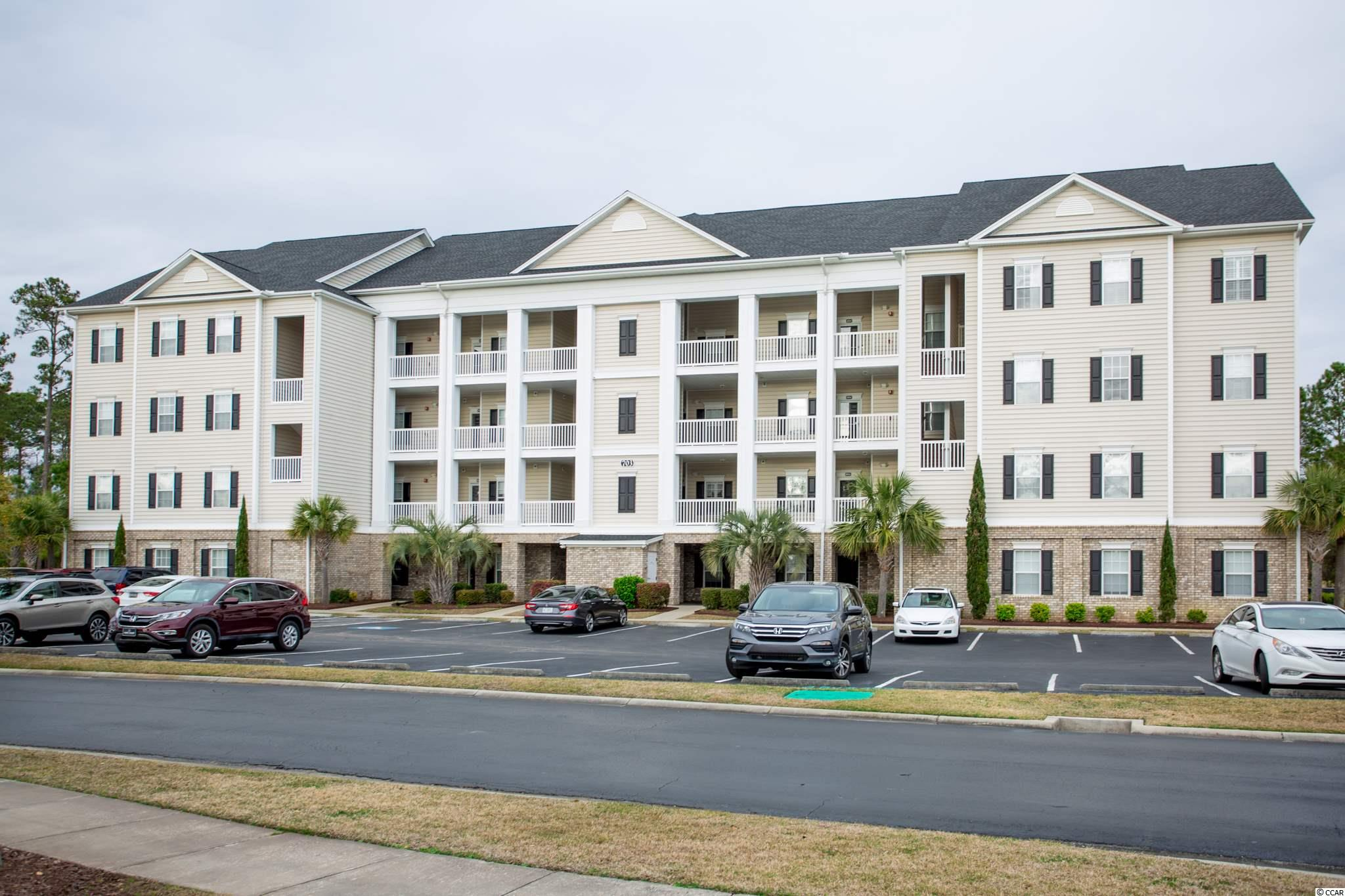 """Stunning 3 bedroom, 2 bath end unit Villa style condo in the gated golf course community of Villas @ International Club in Murrells Inlet. Not your ordinary condo – it is more spacious than most, offers lovely appointments, in an elevator building in a gated community with outstanding golf course and lake views.  Not a cookie cutter condo, the tone is set from the moment you enter this 2nd floor villa through the attractive front door with sidelight.  Enter into an open and elegant foyer with tray ceiling, rope lighting, crown molding, chair rail, tile floors, 5 ¼"""" baseboards and quality architectural details.  Foyer leads into a spacious great/family room with attractive columns, three-sided glass fireplace, tasteful ceiling fan, carpeting and sliders to the screened porch.  Open kitchen with white cabinets and appliances including French door refrigerator, Corian countertops, pantry and breakfast bar.  Bright and cheery dining room with windows and sliders to spacious screen porch overlooking the 13th fairway of International Club Golf Course. Laundry room with washer & dryer that convey and shelving. Split bedroom plan with spacious master bedroom with walk-in closet, tray ceiling, fan, crown molding, wall sconces and sliders leading to the 3-season porch.  Master bath with separate walk-in shower, jacuzzi tub, private water closet, lovely large vanity, two sinks, tile floor and linen closet.  Family and friends will be extremely comfortable on the other side of the condo in the two large guest bedrooms with walk-in closets, crown molding, carpeting and fans.  Guest bath with tile and tub/shower. Start your day on the oversized screened porch sipping your favorite beverage and enjoying the outstanding view of the pond and tree-lined golf course. What a great way to start your day enjoying the peaceful views and nature at its best! This will be the perfect spot to entertain family and friends.  The storage closet on the porch will be ideal for storing golf equipme"""