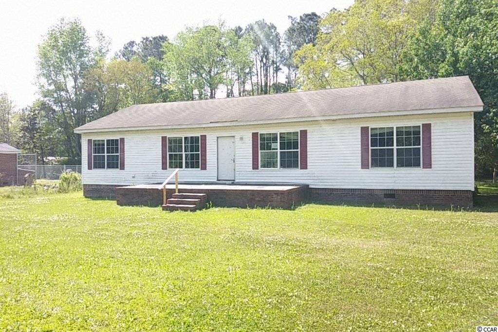 Modular construction home boasts a spacious 4 bedroom 2 bath floor plan plus a large 2 -car detached garage. Public water and sewer.  .47 Acre parcel outside the city limits of Georgetown, SC. Don't miss the unbranded 360 virtual tour, floor plan, and 3D model.