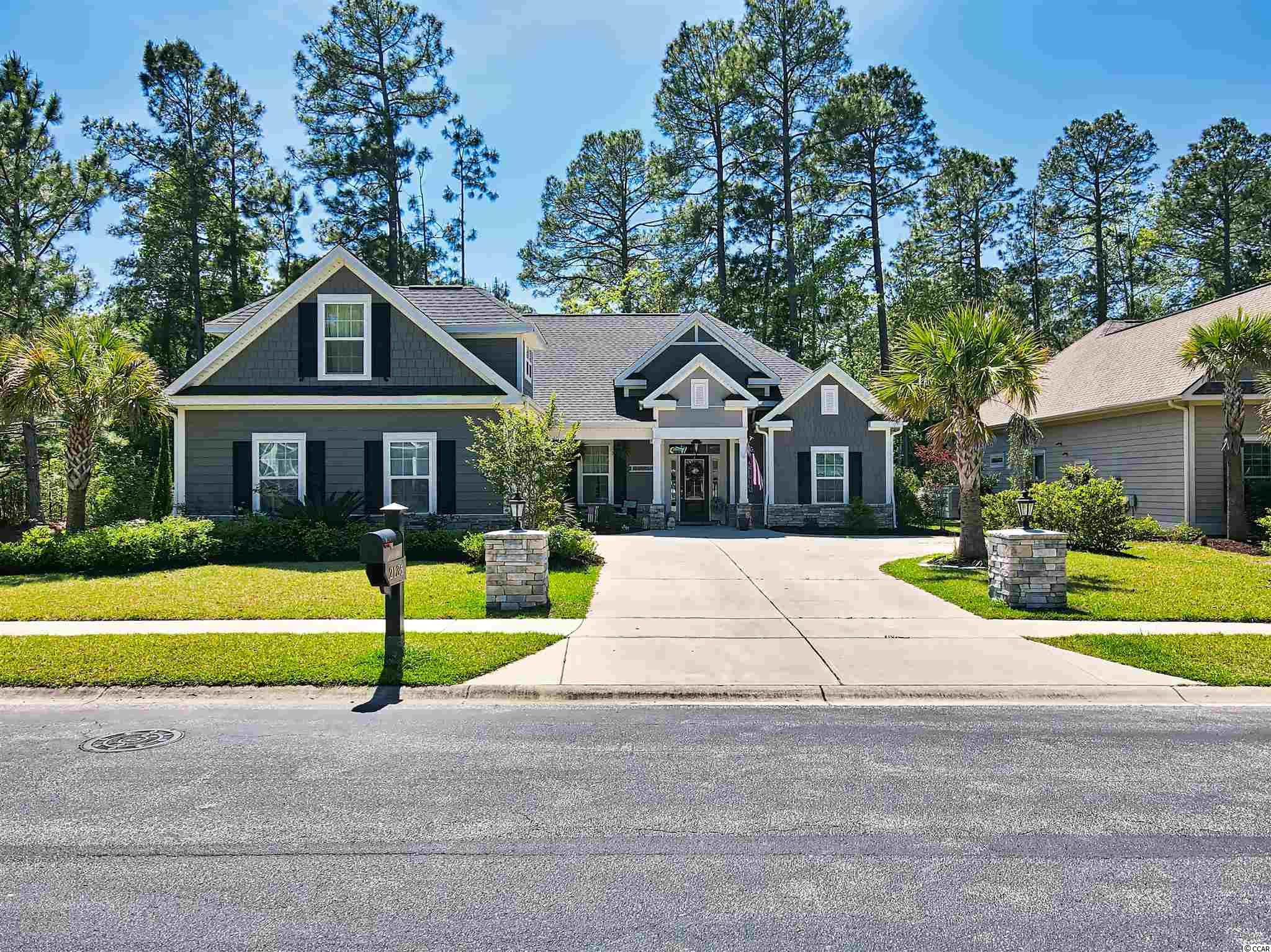 Looking for a recently built custom home in Cypress River Plantation?  Look no further.  This custom home offers 4 bedrooms and 3.5 bathrooms.  There are numerous custom upgrades throughout the entire home such as: chair rail, wainscoting, tray ceilings, crown moulding,  granite counter tops with a gourmet kitchen etc.  As you enter the front door you will notice the wide open floorplan with a cultured stone fireplace.   You will notice the hardwood floors run throughout the first floor.  The great room is a huge space for entertaining.  The master bedroom has a double stack tray ceiling with crown moulding.  The master bathroom has a walk in shower that has custom stone tile from floor to ceiling.  Inside the master suite closet you will find custom built closet organizers.  On the other side of the house there are two spare bedrooms with a full size bathroom between them. There is a jetted tub complete with tile shower in the spare bathroom.  There is a huge bonus space that is 24x12 over the garage that has a full bathroom, built in queen bed and plenty of space for an office or flex space.    The back of the house features a screened in porch that has a door at each end of the 27 foot long space.  Just outside the porch is a custom concrete pad with a half wall area that has cultured stone.  This private area is perfect for grilling and entertaining in the backyard.  A propane line was installed so you will never run out of gas while grilling.   The backyard has black aluminum fencing with custom cultured stone columns.  The yard also comes complete with  an irrigation system and fully landscapped freshly mulched beds.  The front yard has a side entry garage with an oversized concrete pad complete with two lighted columns and cultured stone as you enter.   Cypress River Plantation is one of the most sought after communities in the Grand Strand.  It is gated, with security and backs up to the beautiful Intercoastal Waterway.  Amenities include a huge swimming poo