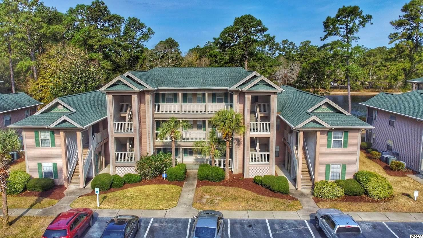 Golfers delight!  Don't miss on this opportunity to own a 2nd floor condo on the True Blue golf course and overlooking a pond.  This unit features 2 bedrooms, 2 bath with luxury vinyl flooring and many upgrades.  Spacious screened in balcony.  Condo comes furnished.