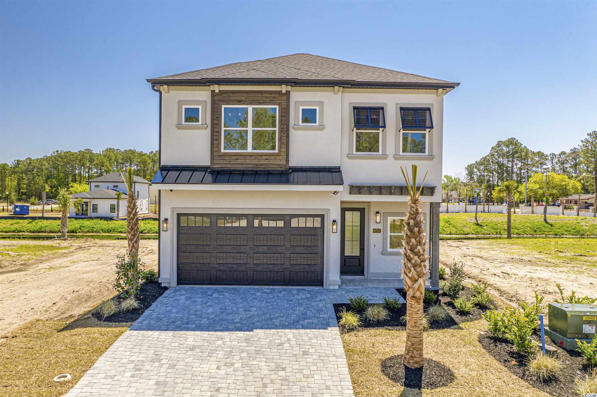Welcome to Ocean Villas at 67th, a gated natural gas community!! This is a brand new, exquisite, gated community of custom modern, open floor plan homes with private lake views in the most desirable area of Myrtle Beach. Located within a short walk or golf cart ride(0.6mile) to the beach, you can enjoy Beach Living Daily. All of the homes will feature traditional stucco adding to the elegance and classiness of the neighborhood. This beautiful Yellow Fin model has a ground level master suite, coffered ceilings in living & dinning rooms, tray ceiling in master suite, walk in pantry, quartz countertops, & all stainless GE Café series appliances. Second floor features two bedrooms, study, & large storage room. There are only thirty-six lots offered in Ocean Villas at 67th, but each of the lots offer a private lake view for relaxing and enjoying the tranquil surroundings. Ocean Villas at 67th is centrally located just minutes to the Best Shopping, Dining, Entertainment, Golf Courses, Medical Facilities, Post Office, and of course BEACHES that the Grand Strand has to offer. Check out Ocean Villas at 67th TODAY, and Allow yourself to Live in an Atmosphere of Luxury and Comfort just minutes from the Atlantic Ocean.