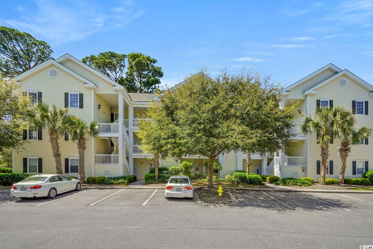"""Spacious Top Floor Unit boasts 12' vaulted ceiling in LR/DR, 10' tray ceiling & walk-in closet in Master BR. 2 exterior storage closets, extra large 28' screened porch off LR & Master BR with pool view.  Hot Water Heater 2013 and Upgraded dishwasher. Custom paint and beautiful furnishings along with luxury vinyl plank flooring. Excellent quality carpet in bedrooms. Upgraded ceiling fan & lighting in LR/DR. Custom window treatments in LR & Master BR. Very nice porch furniture. Beautiful ceiling fans on porch. 55"""" HDTV in living room wall mounted. Pantry. Side by side washer dryer. Upgraded over head lighting in hallway and kitchen. French doors on 3rd bedroom. Amenities galore! Voted#1 gated community in North Myrtle Beach, 6 swimming Pools/hot tubs, fitness facility, recreation facility w/pool table, tennis courts, BBQ & picnic areas throughout community, beautiful walking trails, lakes & ponds. Also a Very short golf cart or walk to the beach and historic MainStreet for shopping, dining & entertainment, or a short drive to all the fun happenings in the Myrtle Beach area. Square footage is approximate and should be verified by buyer."""