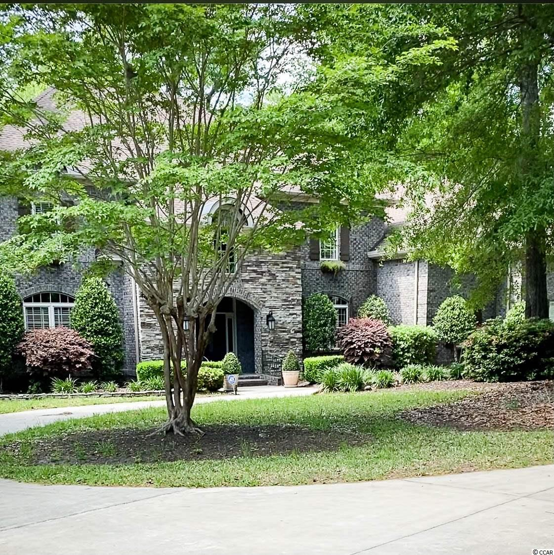 This stunning custom built home sits on 1.43 acers with a wooded view that is protected from any future development. Offering 5 bedroom, 3 full bathrooms and 2 half baths plus a bonus room. Bonus room has  access to a full size bathroom, a wet bar, sink and mini fridge PLUS a private entrance. Perfect for a guest suite or could even be used as a 6th bedroom. This home has countless custom features including built in cabinetry, a wet bar located in the formal dining room, cherry wood flooring and a gourmet kitchen with an island, walk in pantry, granite countertops and a spacious dining area that is perfect for entertaining. The spacious living room has built in cabinets, a gas fireplace and leads to the screened in porch with relaxing views of the back yard.  Master bedroom is conveniently located on the first floor, has a walk in closet with built in shelving, double tray ceilings and plenty of windows.  Master bathroom does not disappoint, here you will find his and her vanities, a large walk-in tiled shower, jacuzzi tub, and a closet. Upstairs you have 4 large bedrooms and two full bathrooms. Spacious 3 car garage and large circular driveway allows plenty of room for a boat.  Creek Ridge Plantation is close to shopping, dining and entertainment, including Garden City Beach, Huntington State Park, Marsh Walk and so much more. Do not miss out on this exquisite home located in beautiful Murrells Inlet.