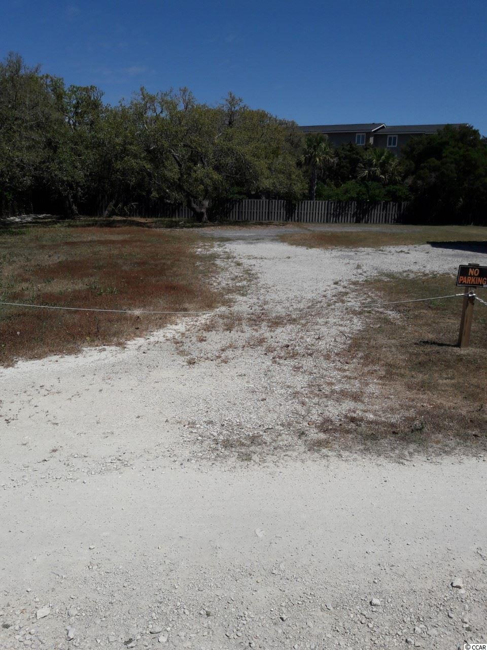 Great buildable lot with short walk to beach on private road.